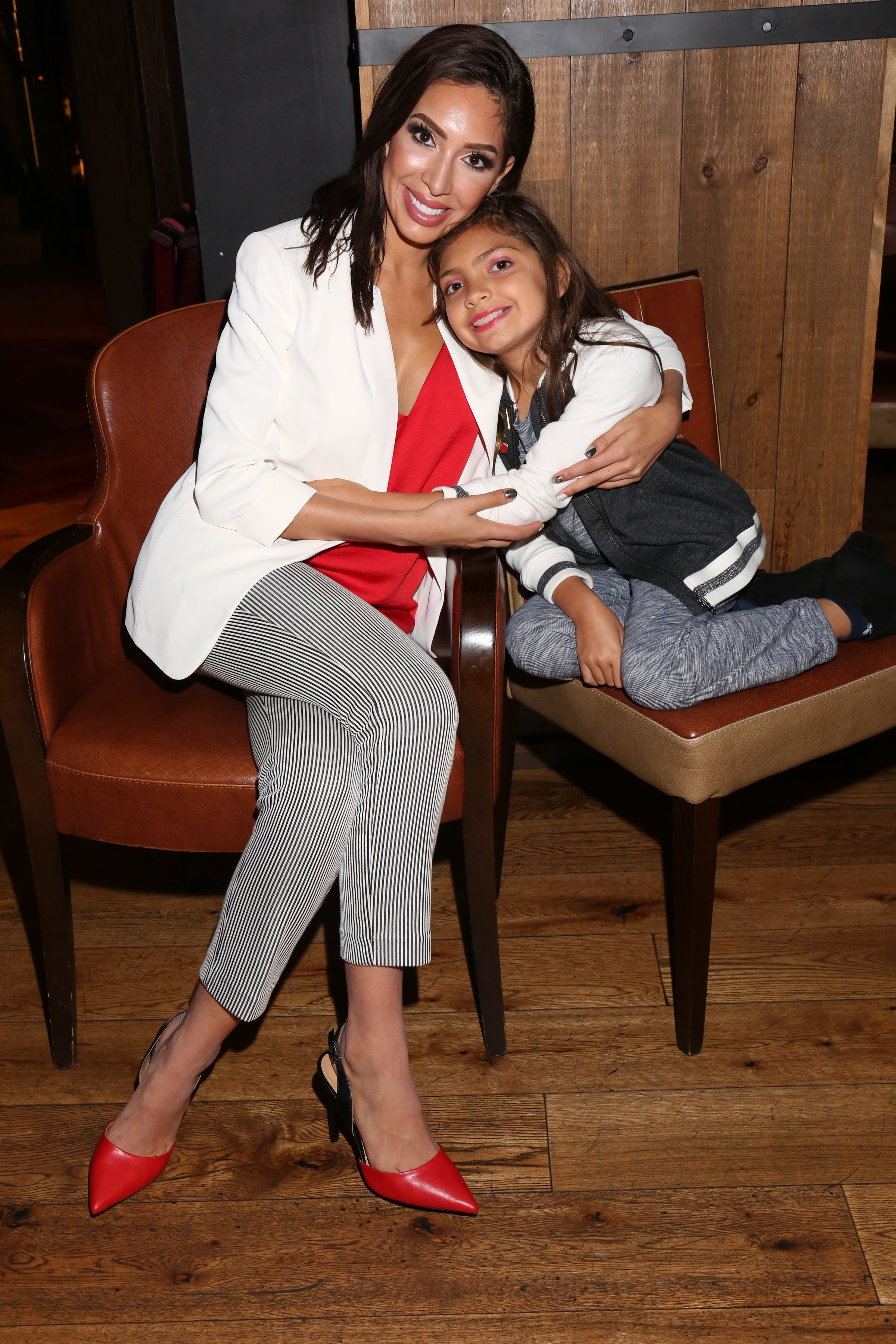 Farrah Abraham cuddled up to her daughter Sophia while attending the Celebrity Boxing Press Preview in New York City on Aug. 21, 2018.