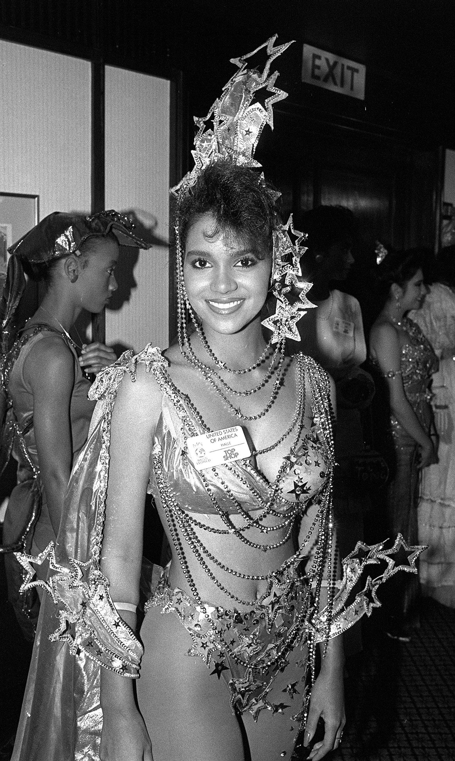 Miss USA Halle Berry poses at a Variety Club of Great Britain luncheon in 1986.
