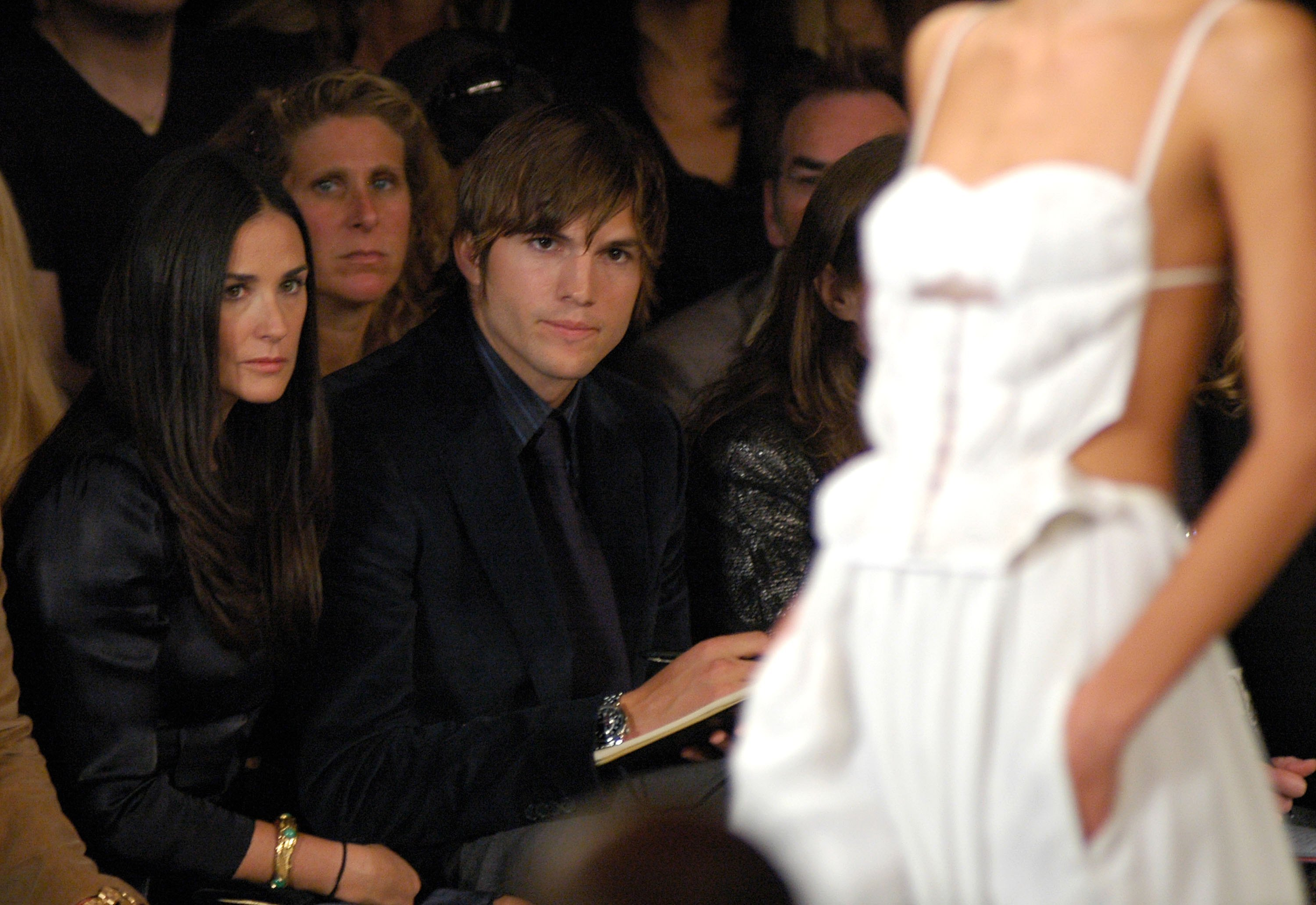 Demi Moore and Ashton Kutcher attend the Narciso Rodriguez Spring 2007 fashion show during Olympus Fashion Week in New York City on Sept. 12, 2006.