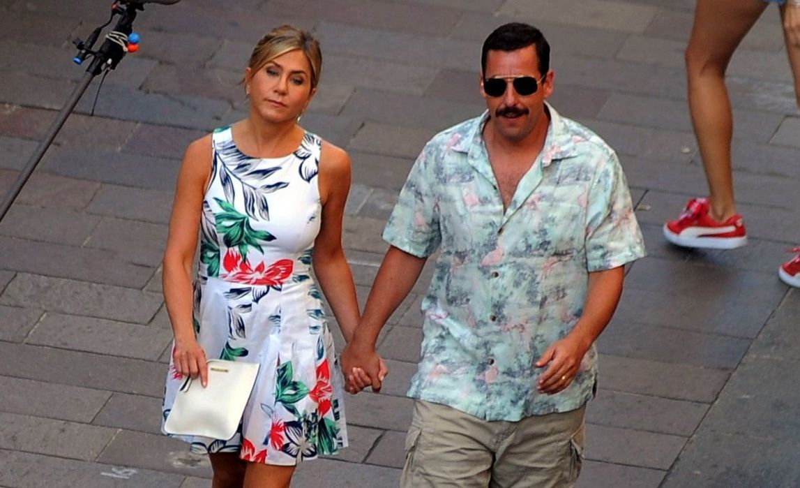 """Jennifer Aniston and Adam Sandler appear on set filming """"Murder Mystery"""" in Milan, Italy, on Aug. 27, 2018."""