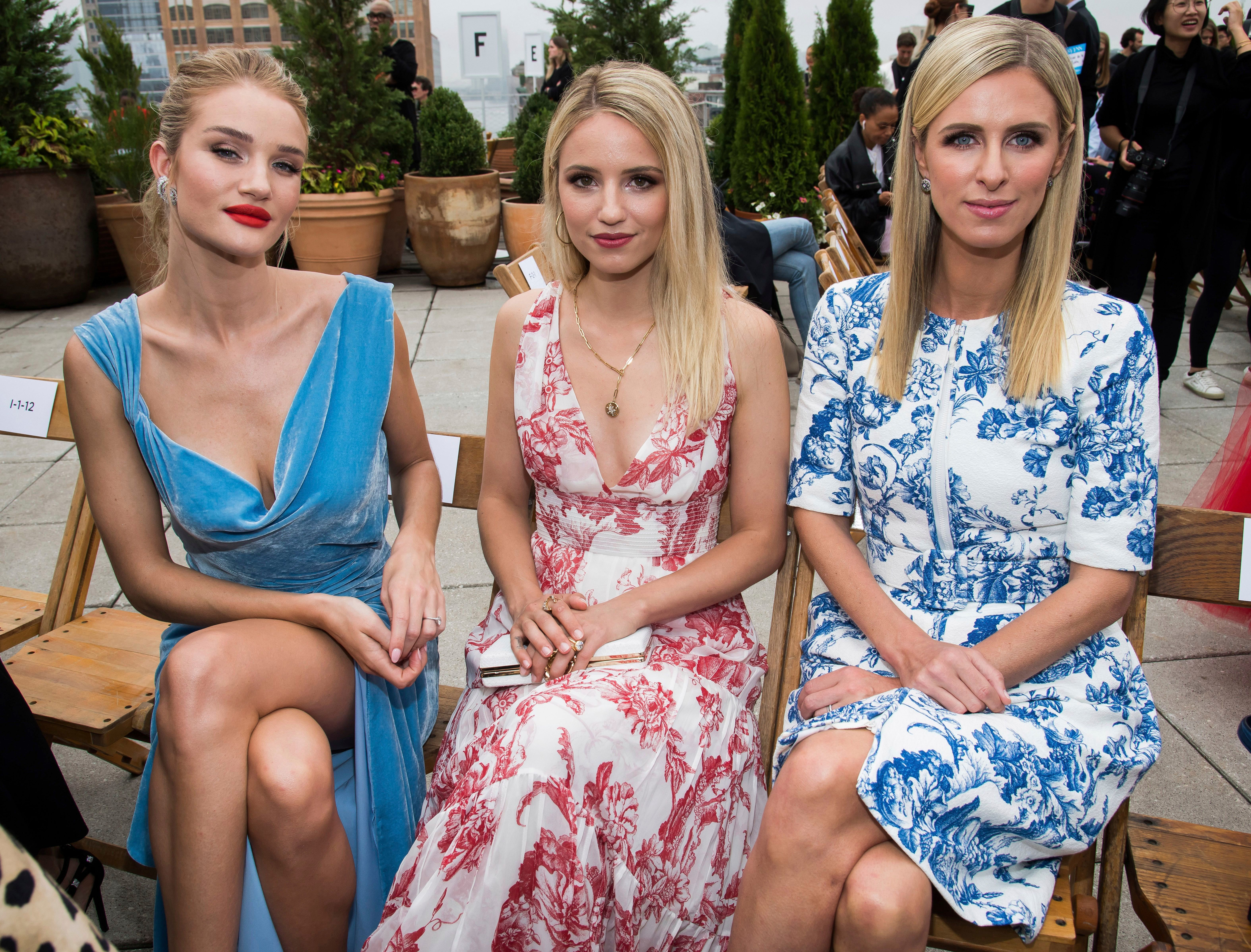 Rosie Huntington Whiteley, Dianna Agron and Nicky Hilton Rothschild attend the Oscar de la Renta show during Fashion Week on in New York City on Sept. 11, 2018.