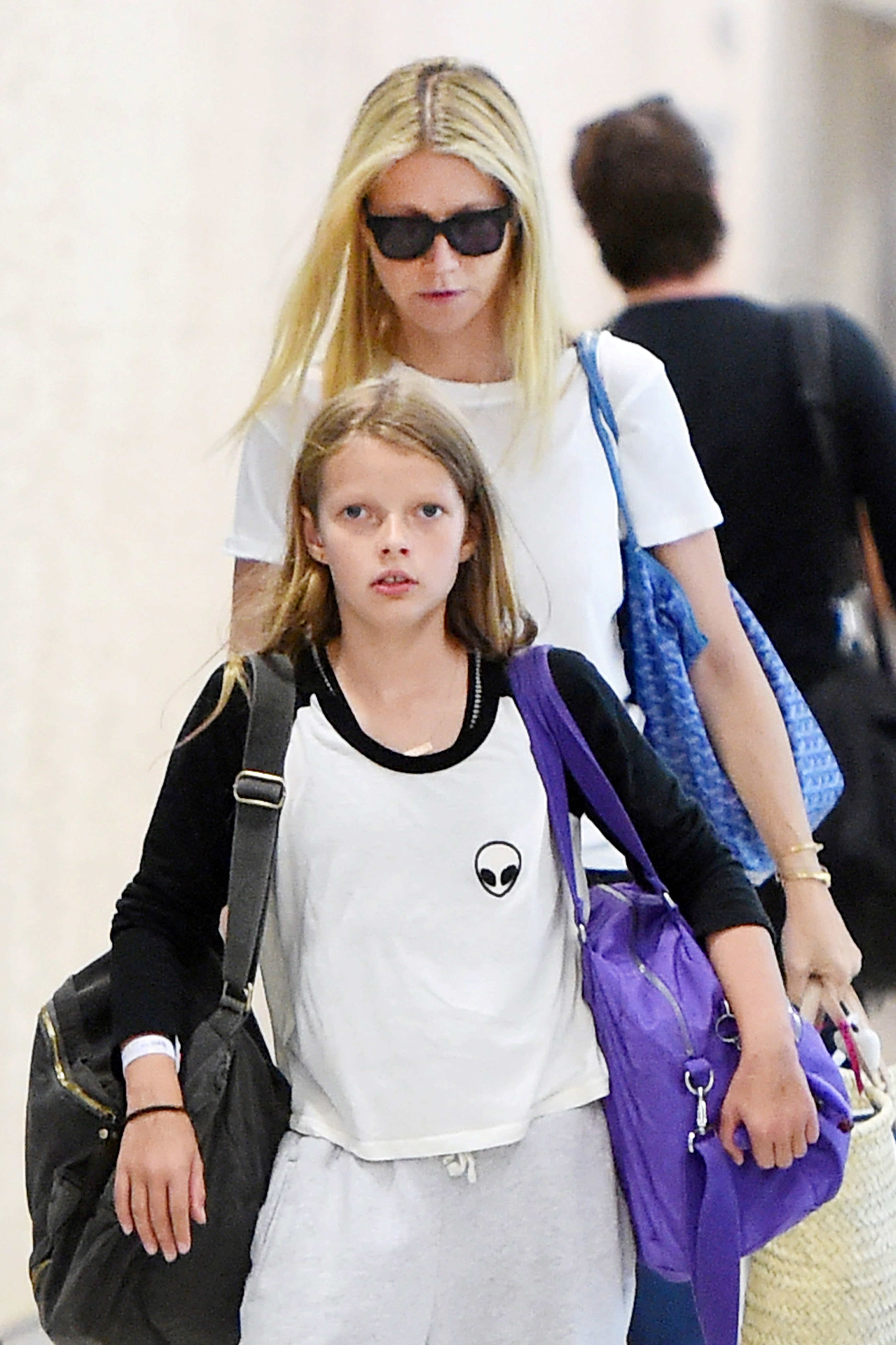 Actress Gwyneth Paltrow arrives with her kids, Apple Martin and Moses Martin at JFK Airport in New York City on June 29, 2015.