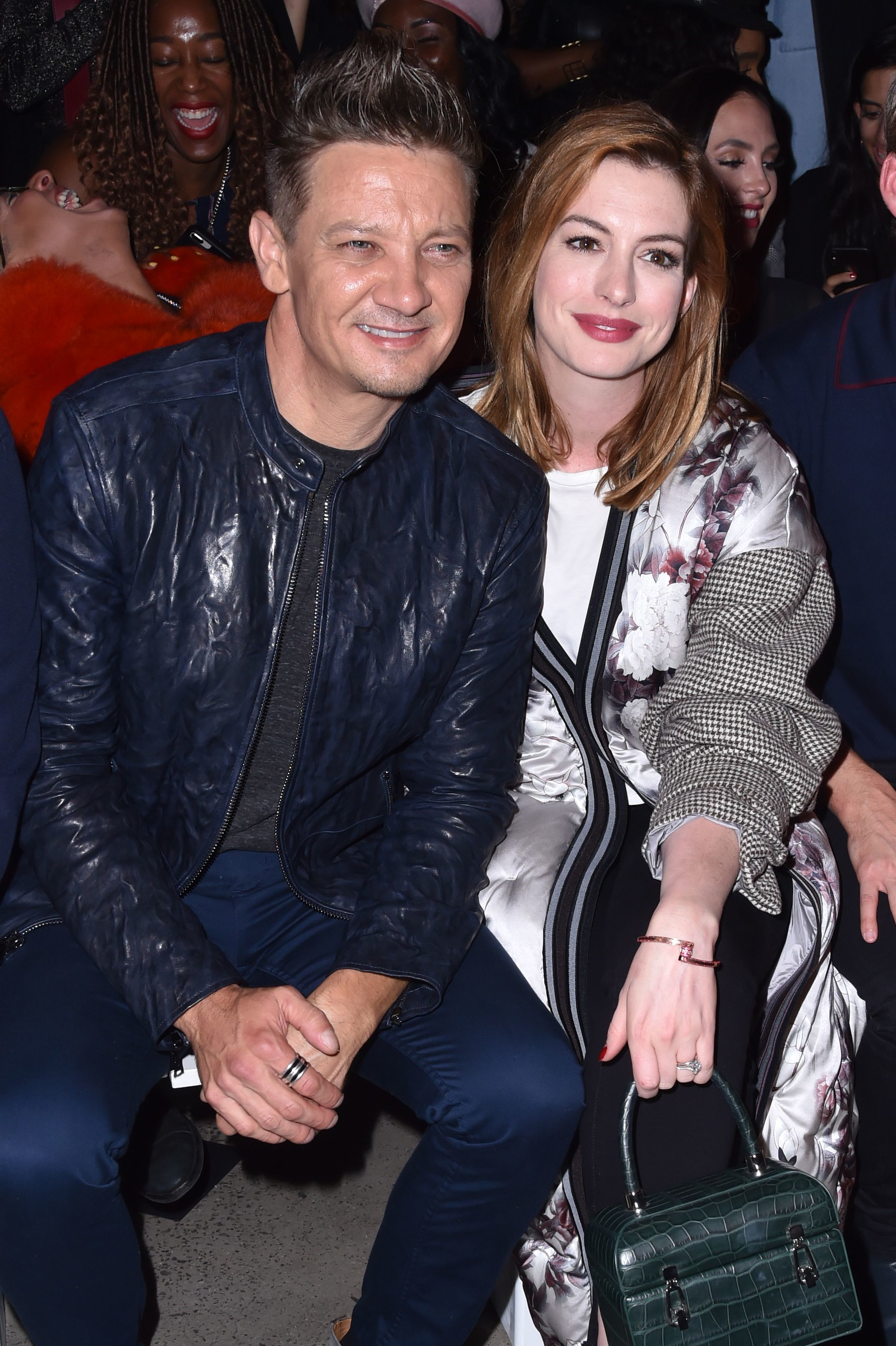 Jeremy Renner and Anne Hathaway attend the Bosideng show for Spring/Summer 2019 at New York Fashion Week on Sept. 11, 2018.