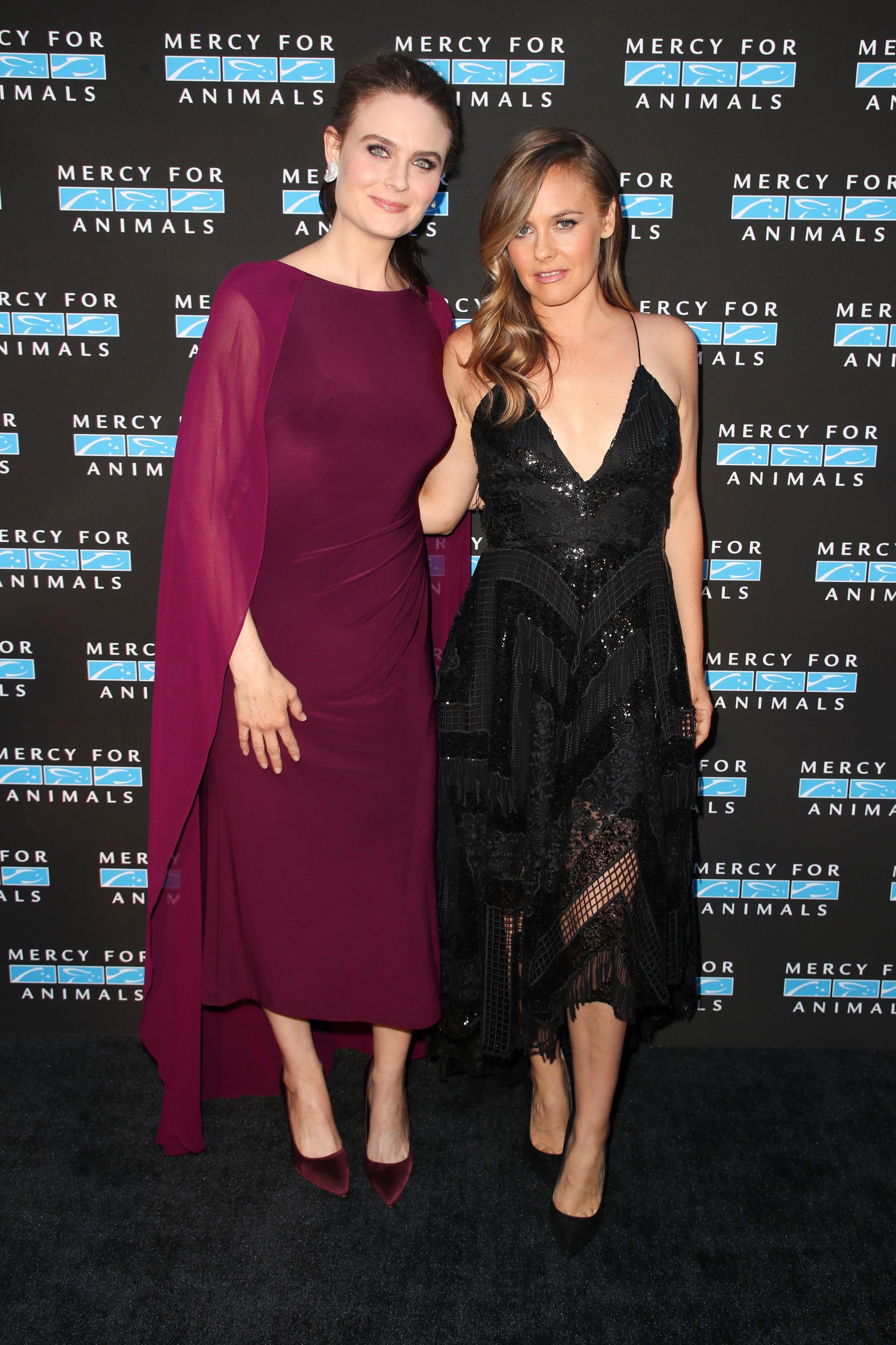 Emily Deschanel and Alicia Silverstone attend the Mercy for Animals Gala in Los Angeles on Sept. 15, 2018.