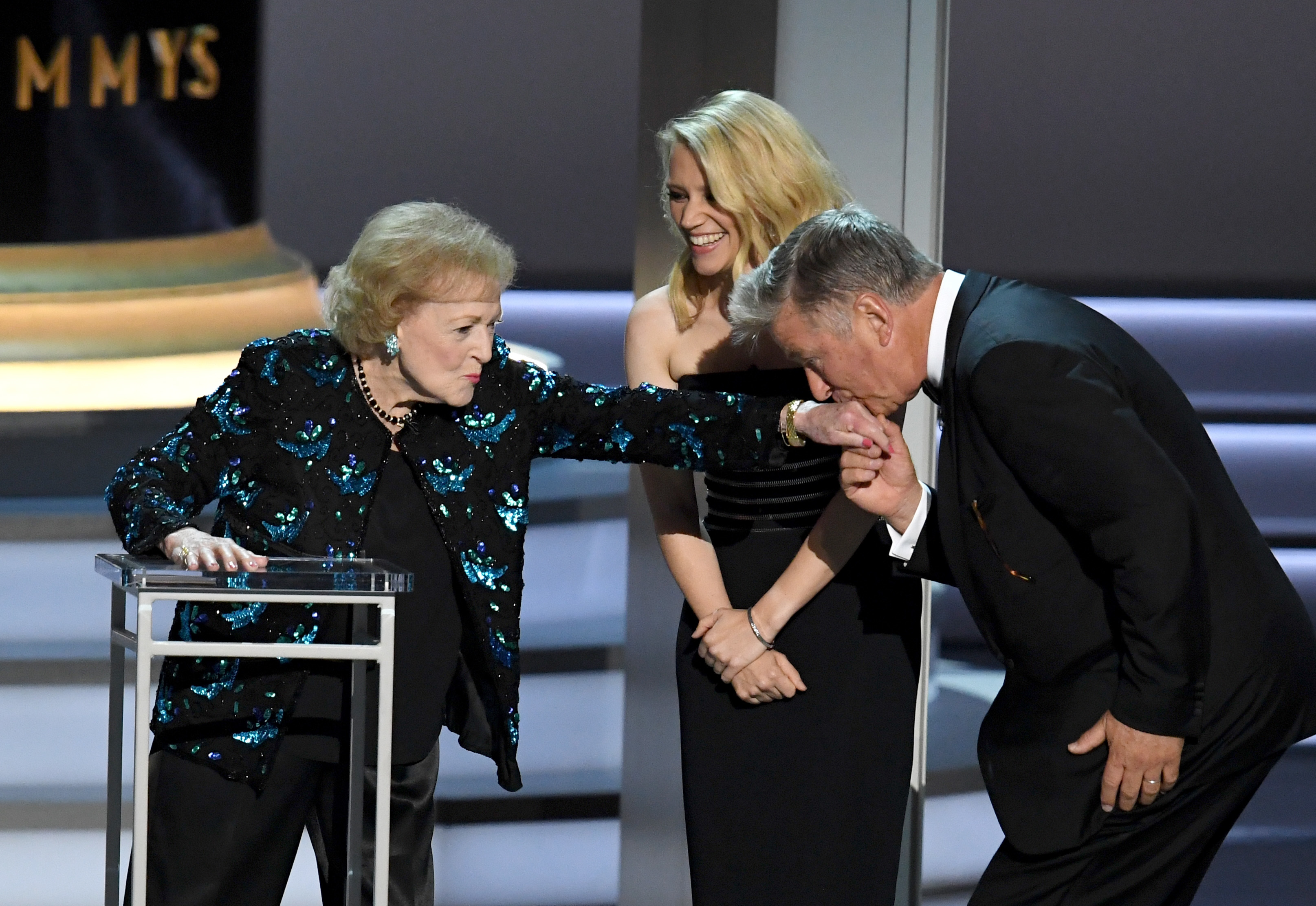 Betty White, Kate McKinnon and Alec Baldwin speak onstage during the 70th Emmy Awards at the Microsoft Theater in Los Angeles on Sept. 17, 2018.