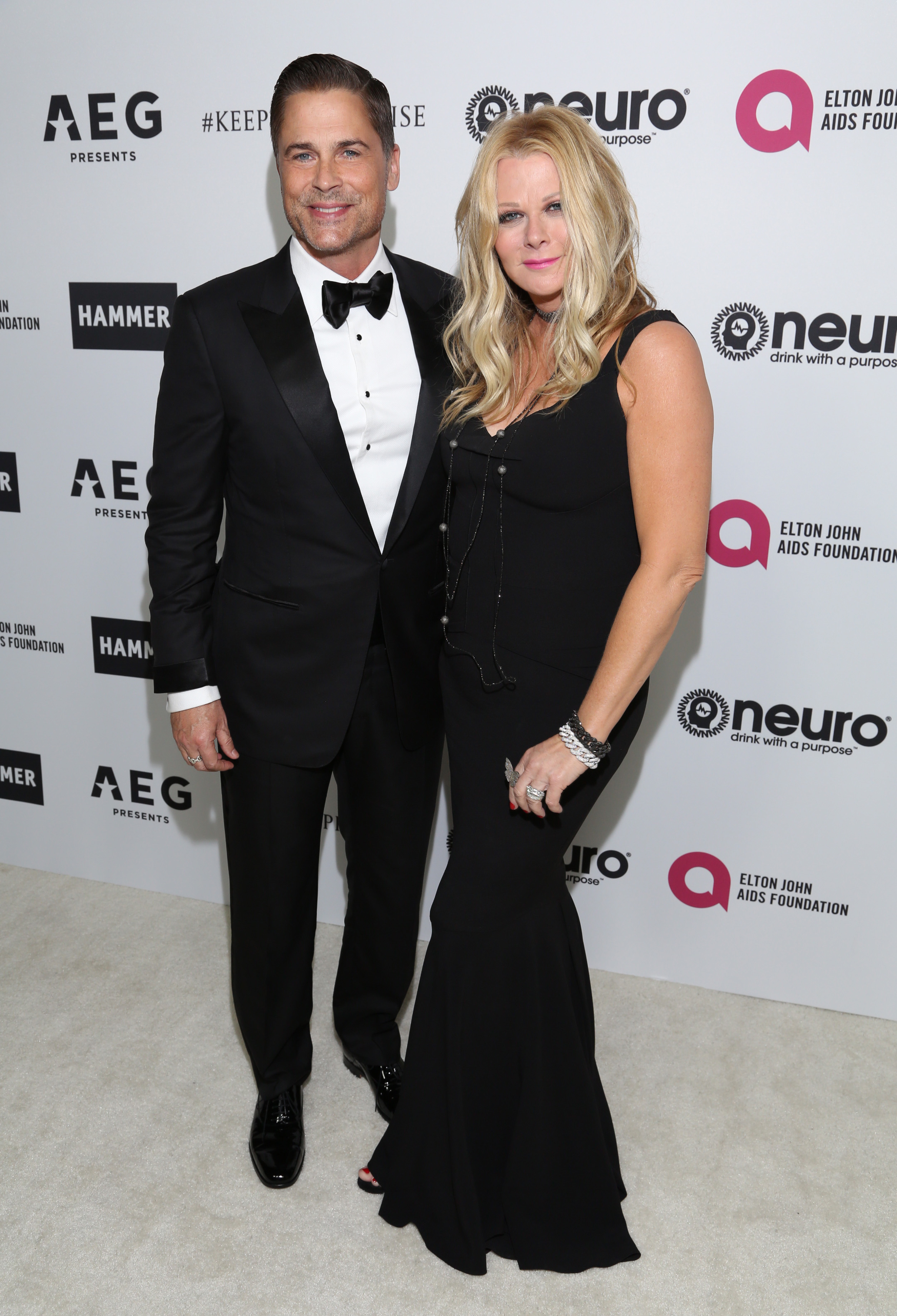 Rob Lowe and wife Sheryl Berkoff attend Elton John's 70th birthday party in Los Angeles on March 25, 2017.