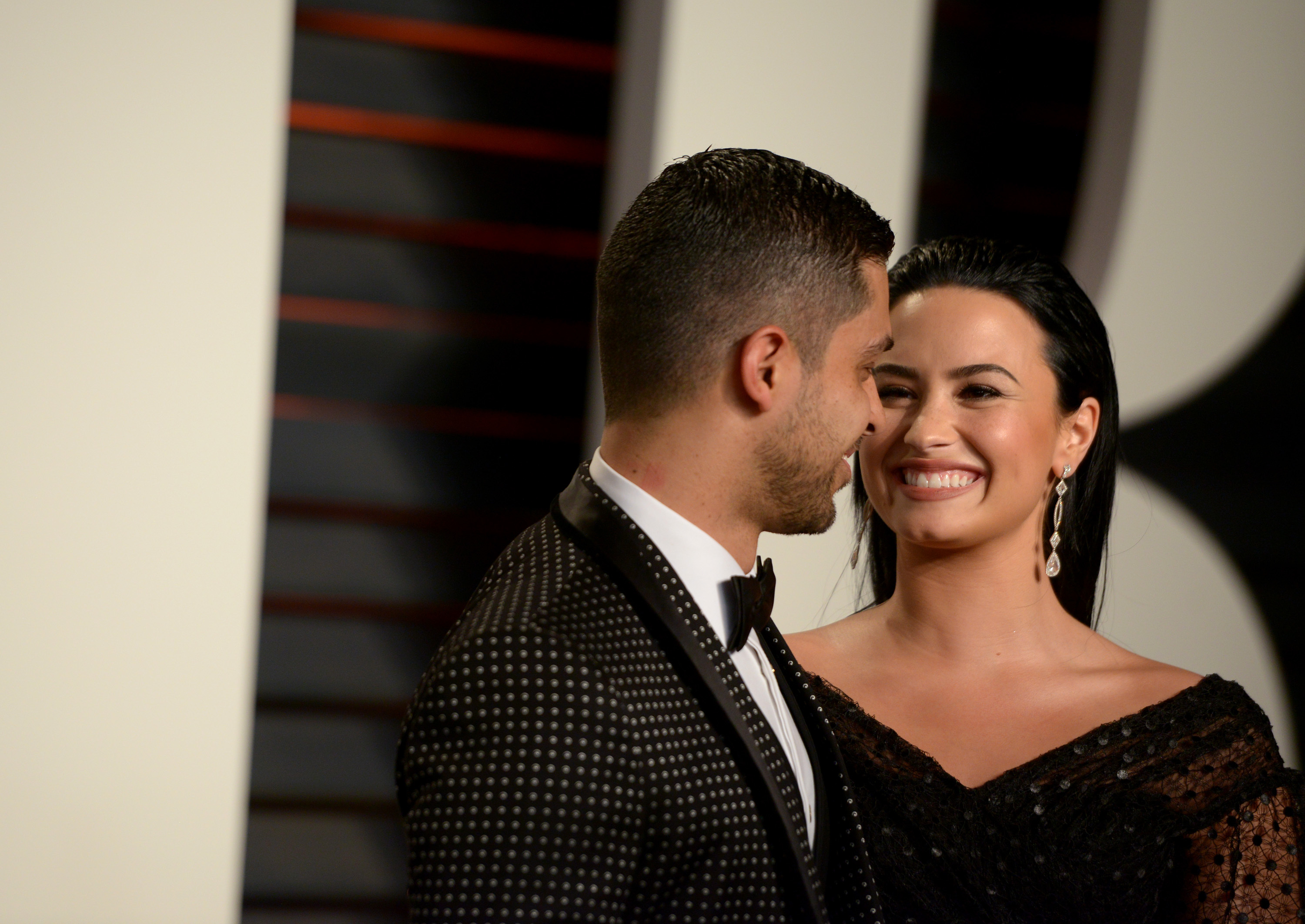Wilmer Valderrama and Demi Lovato attend the Vanity Fair Oscar Party in Beverly Hills on Feb. 28, 2016.