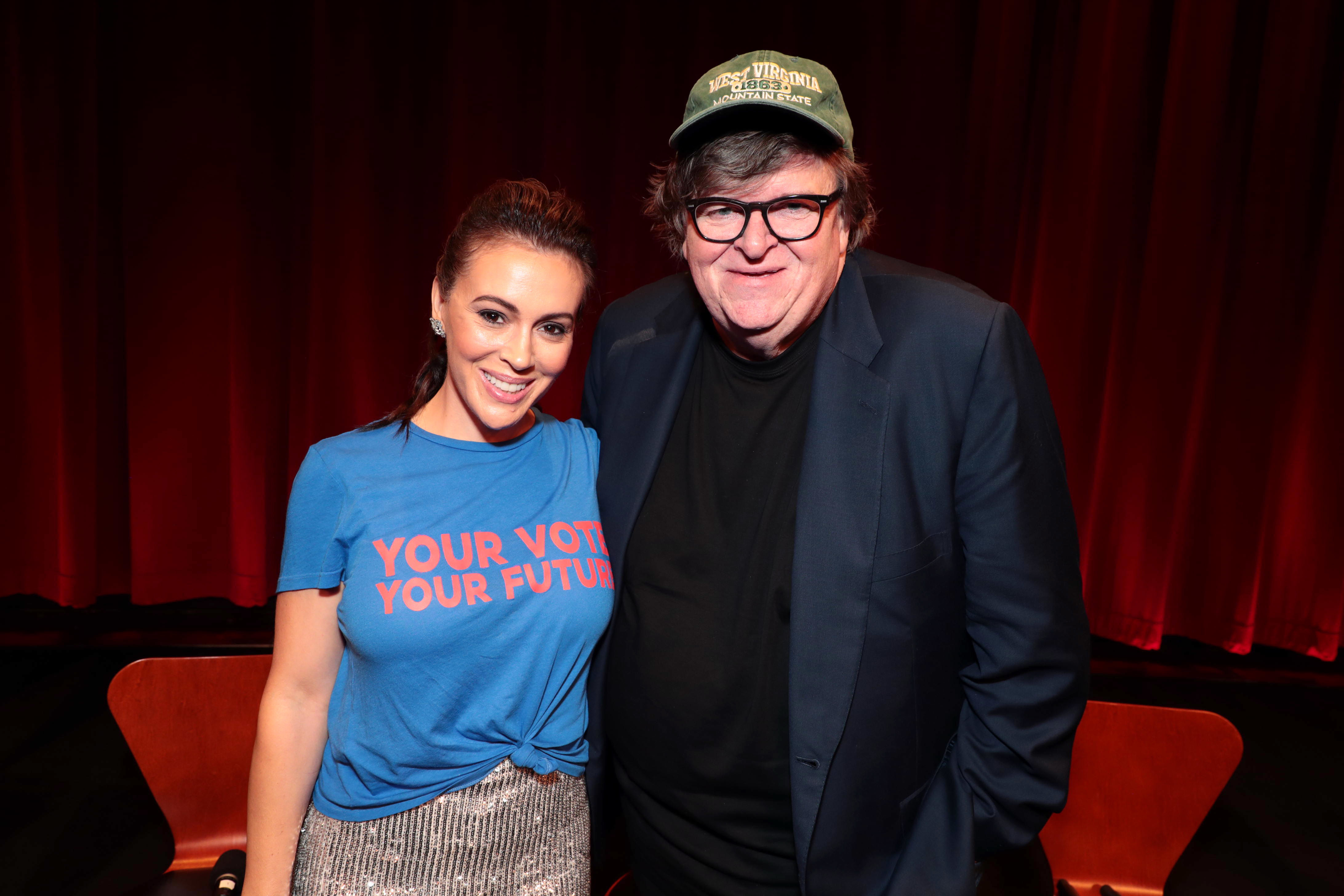 """Alyssa Milano and Michael Moore attend the """"Fahrenheit 11/9"""" in Los Angeles on Sept. 19, 2018."""