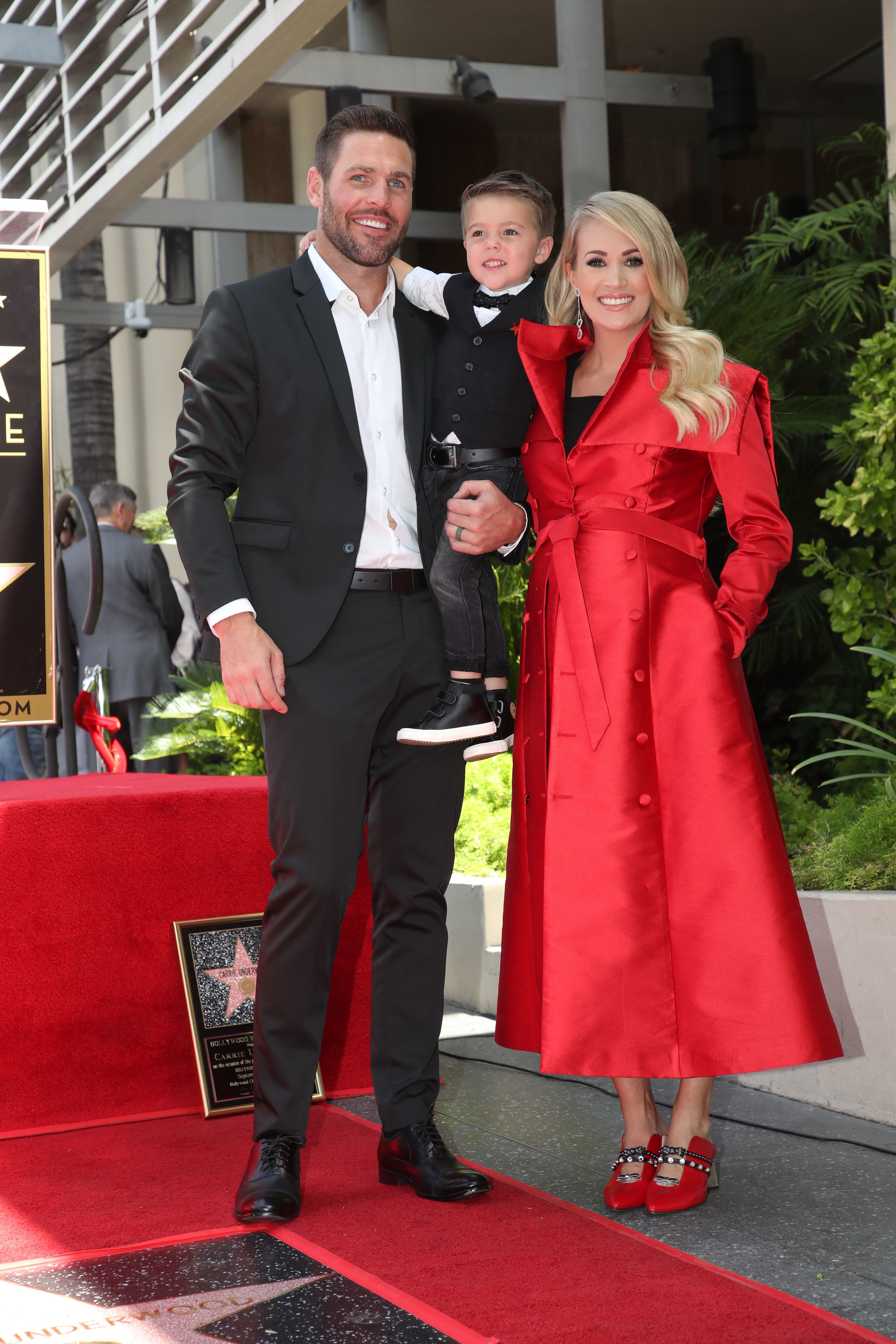 Carrie Underwood, Mike Fisher and son Isaiah pose at her Hollywood Walk of Fame star ceremony on Sept. 20, 2018.