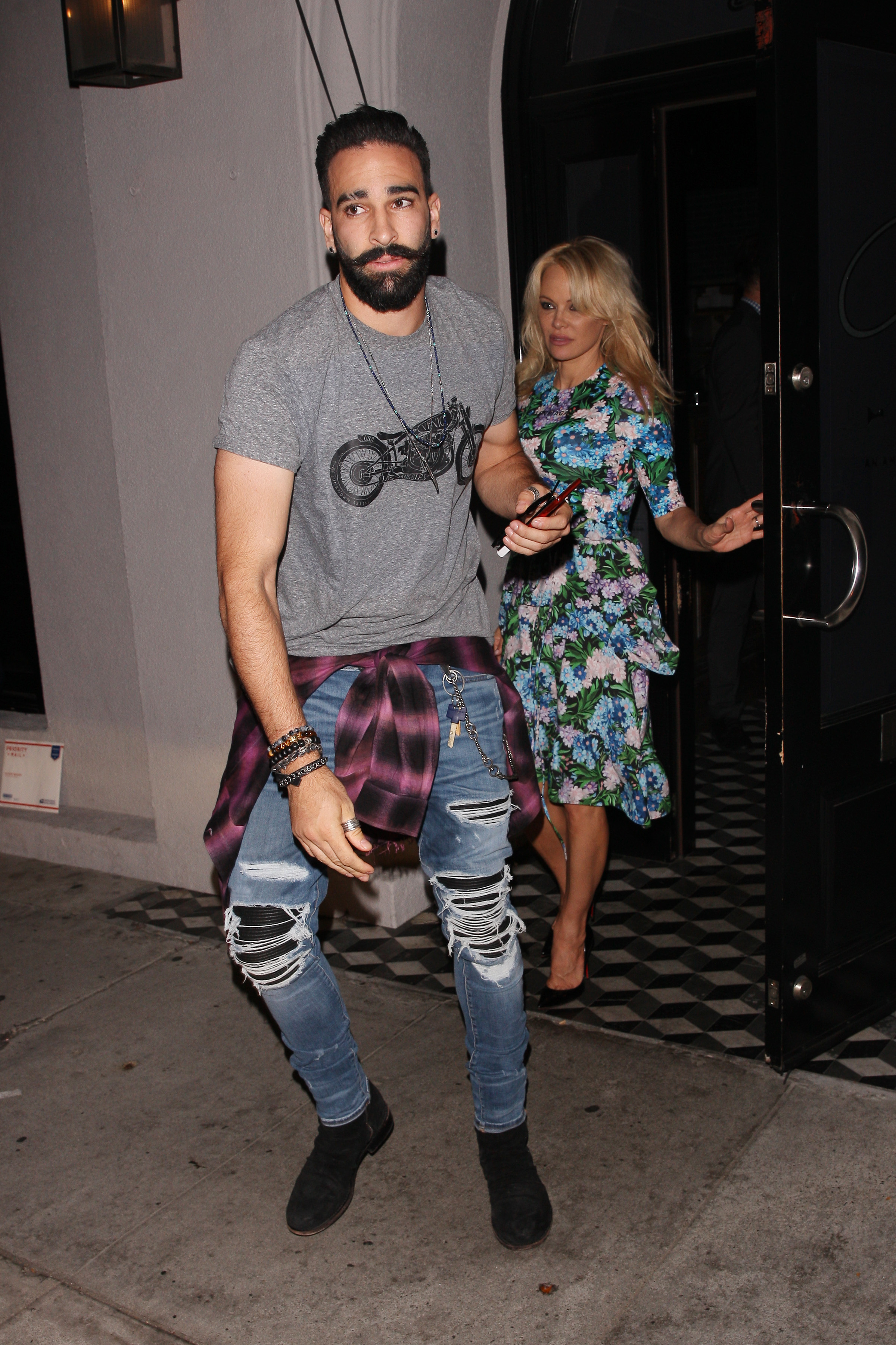 Adil Rami and Pamela Anderson head to Craig's restaurant in West Hollywood on July 24, 2018.