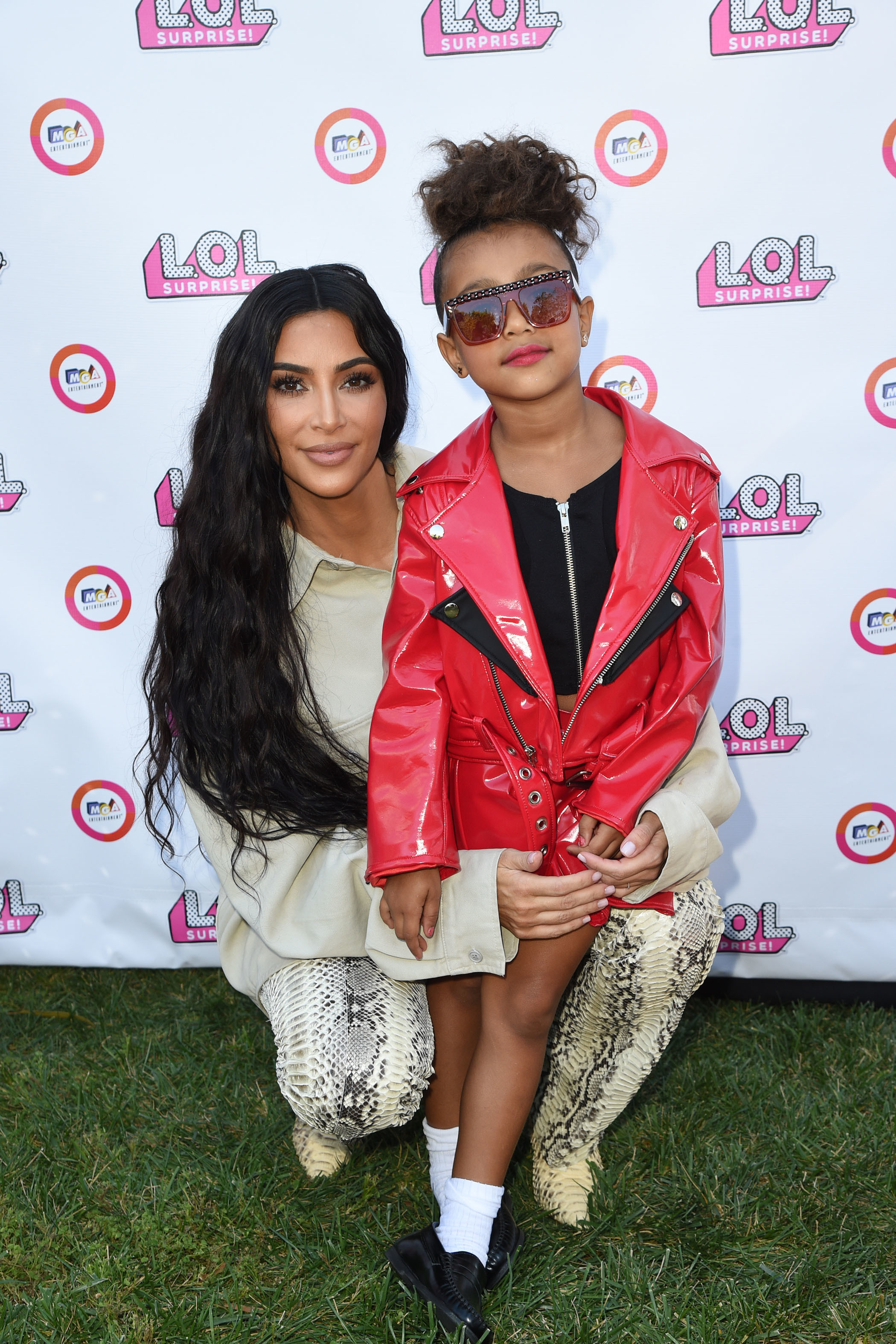 Kim Kardashian West poses with daughter North West, who modeled at the event, at the L.O.L. Surprise! fashion show in Los Angeles on Sept. 22, 2018.
