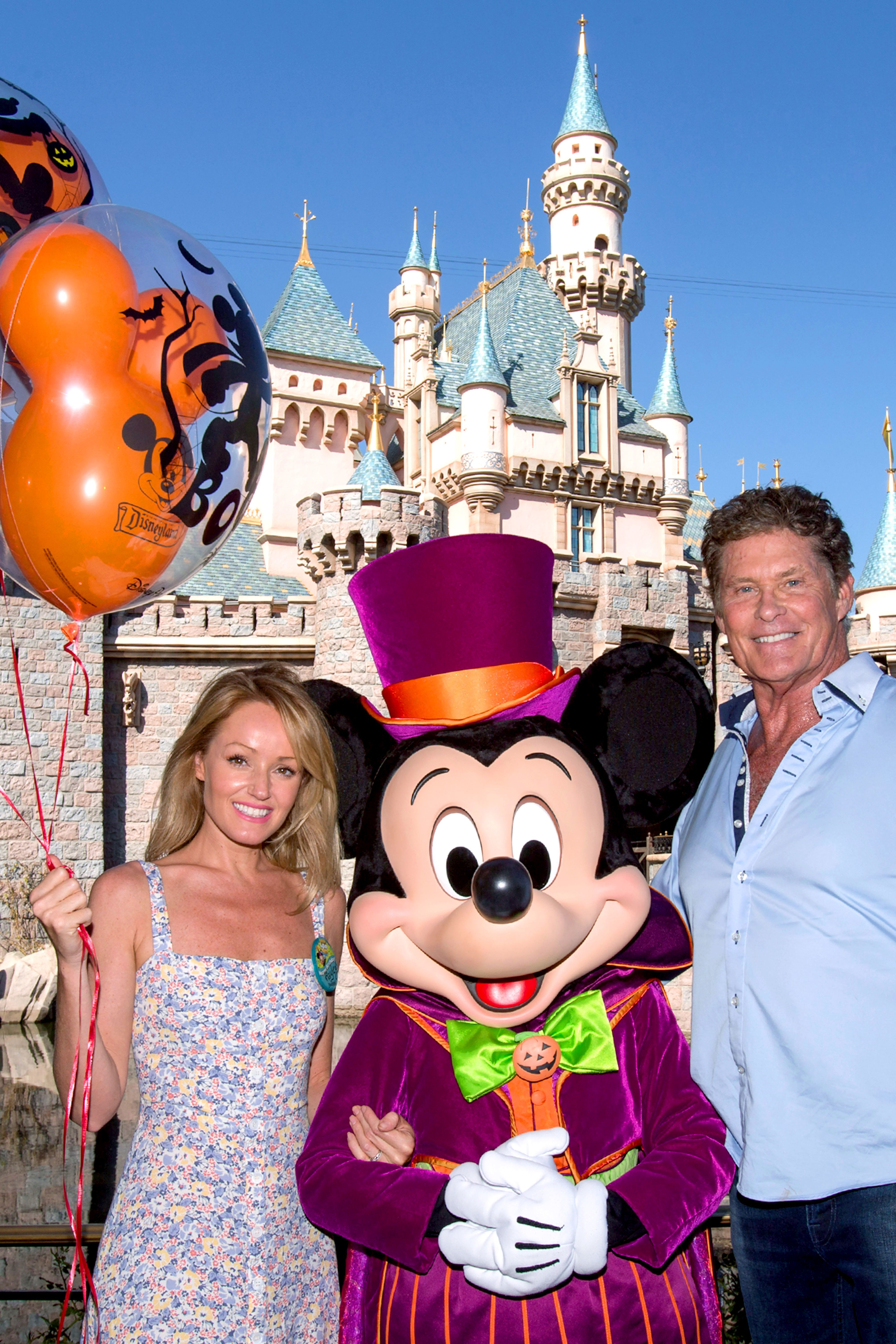 David Hasselhoff celebrates wife Hayley Roberts' birthday with Mickey Mouse during Halloween Time at Disneyland in Anaheim, California, on Sept. 19, 2018.
