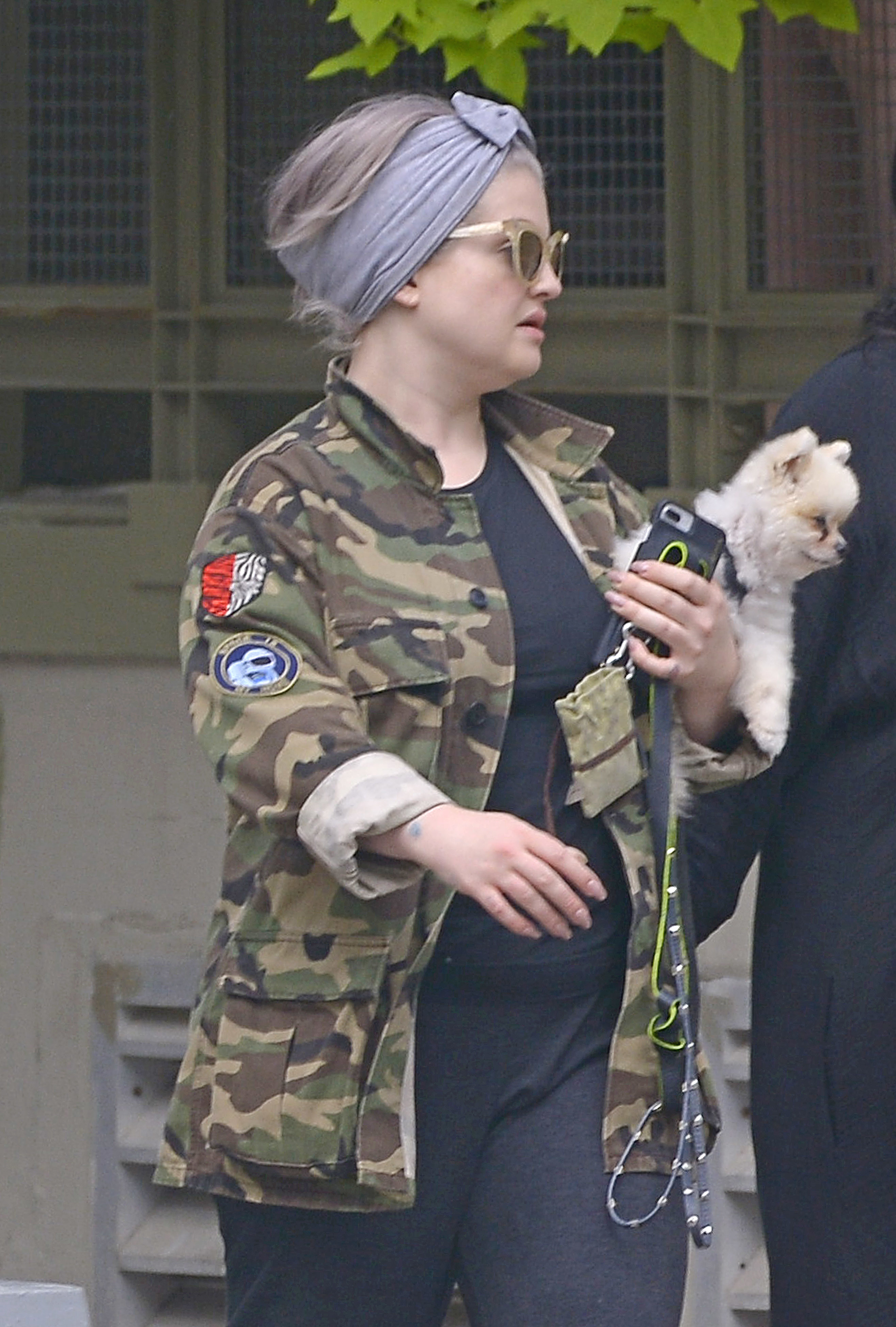 Kelly Osbourne carried her pooch while walking with her stylist friend in New York City on Oct. 1, 2018.