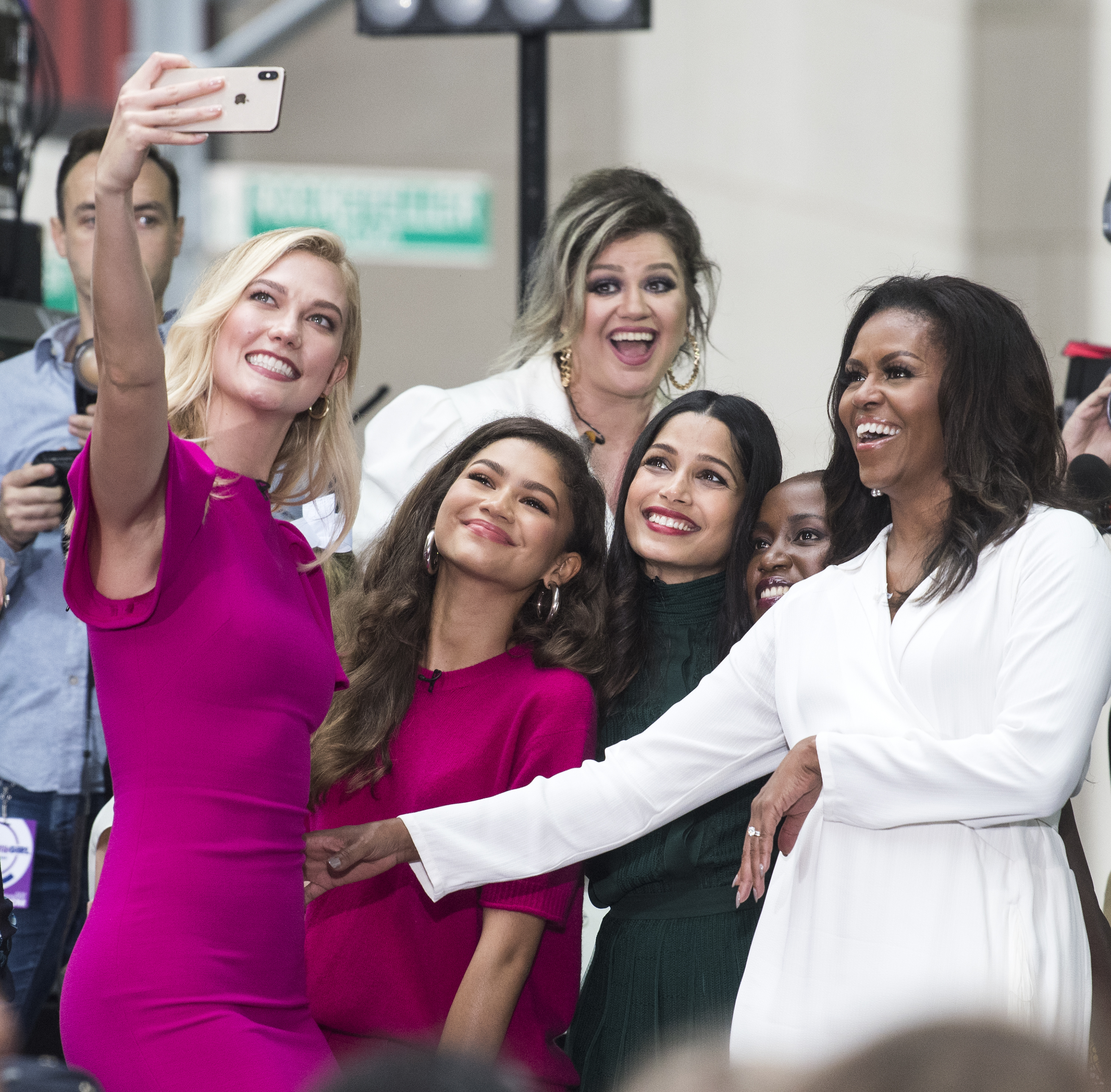 "Karlie Kloss, Zendaya,  Kelly Clarkson, Freida Pinto, and Michelle Obama take a selfie while they  Celebrate International Day of the Girl on NBC's ""TODAY"" at Rockefeller Plaza in New York City on Oct. 11, 2018."
