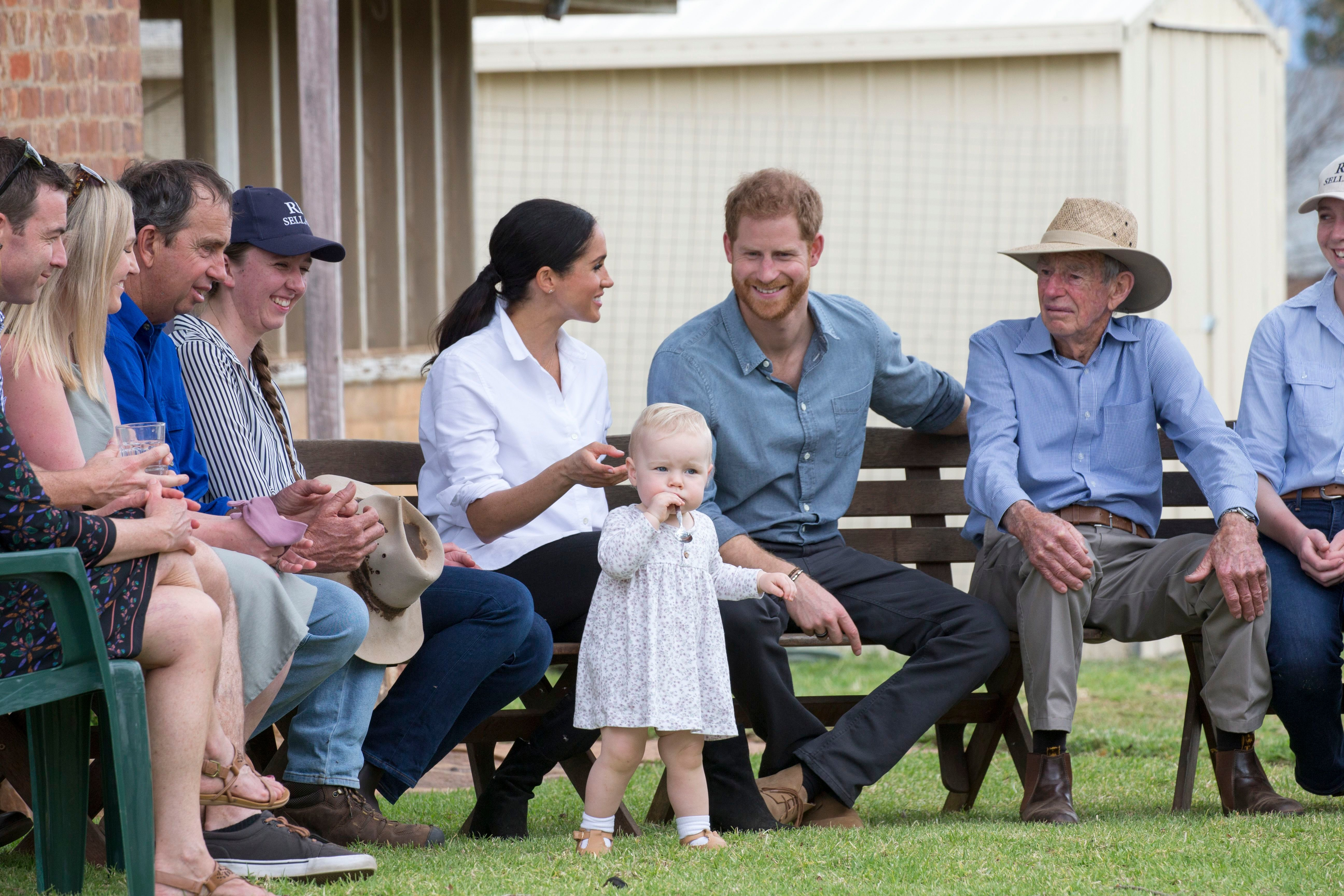 Prince Harry and Duchess Meghan relax at Mountain View, a family run farm in Dubbo, New South Wales, Australia, on day 2 of their royal visit Down Under on Oct. 17, 2018.