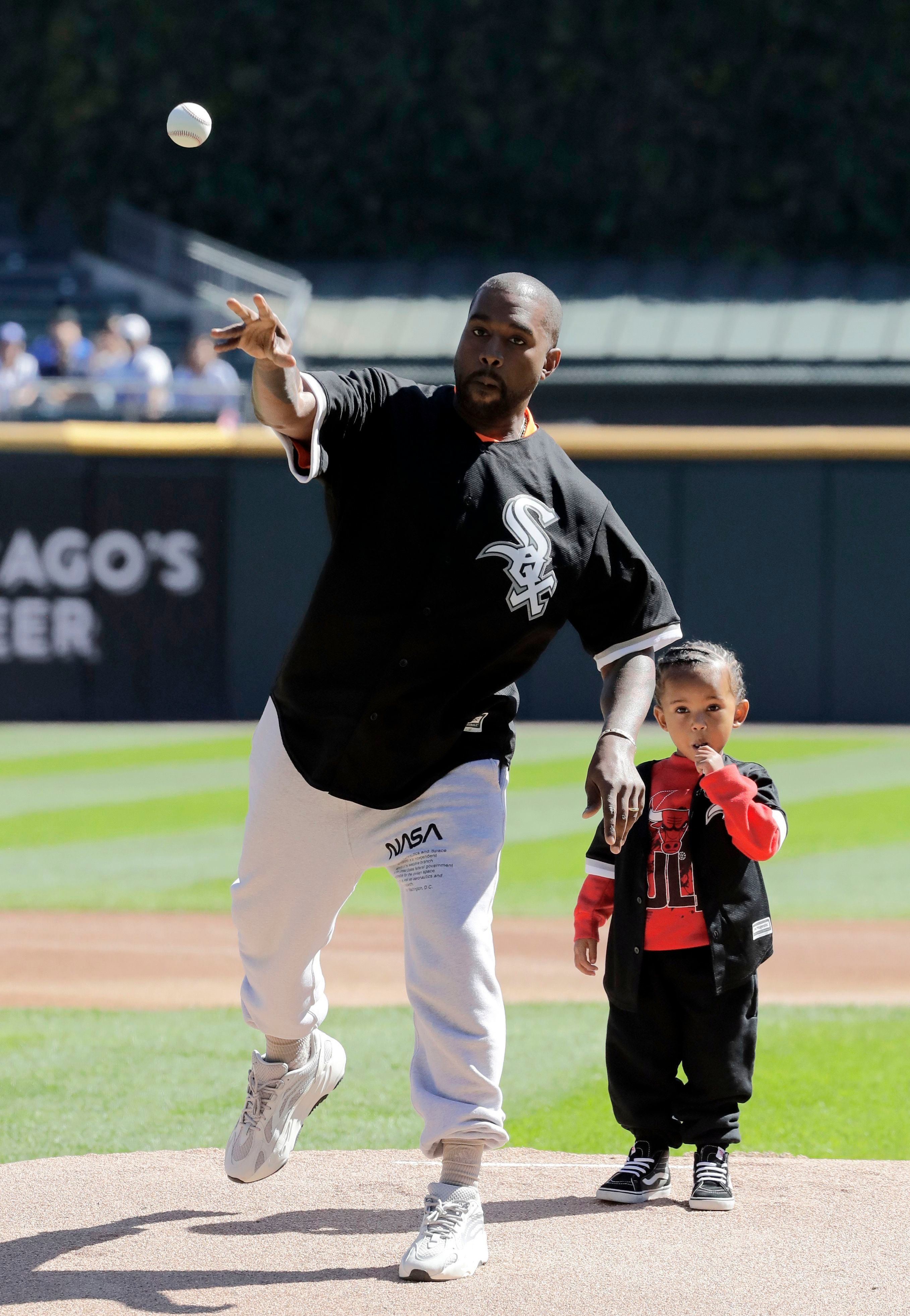 Kanye West and his little boy Saint threw the first pitch at a Chicago White Sox game in Chicago on Sept. 23, 2018.