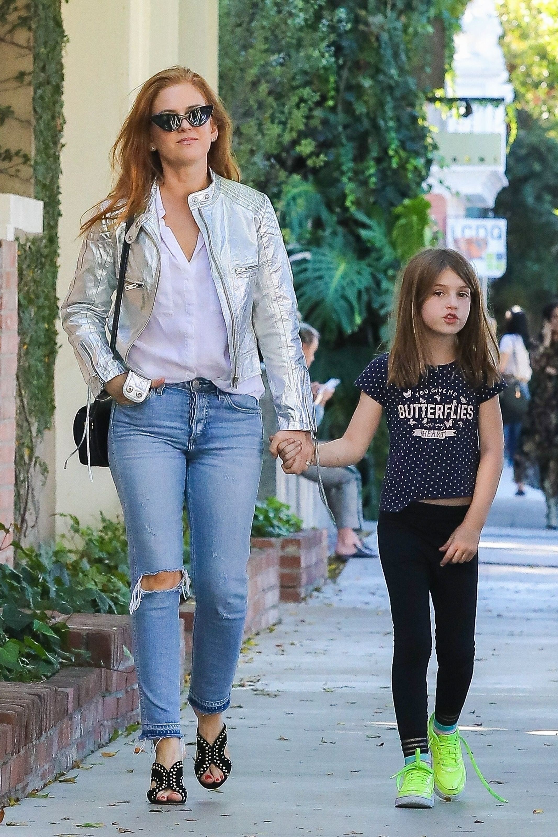 Isla Fisher held hands with daughter Elula Cohen as they visited a few shops on Melrose Place in West Hollywood on Oct. 16, 2018.