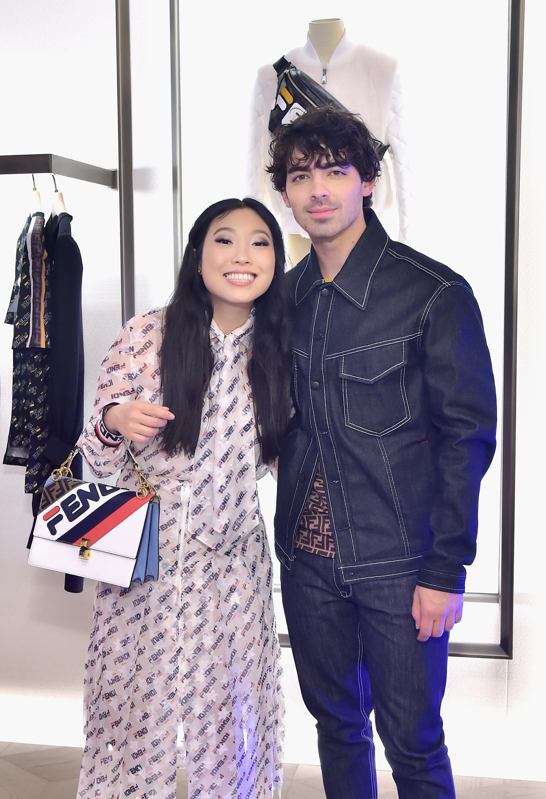 Awkwafina and Joe Jonas attend the FENDI MANIA Capsule Collection Launch Event at Fendi in Beverly Hills, California, on Oct. 16, 2018.