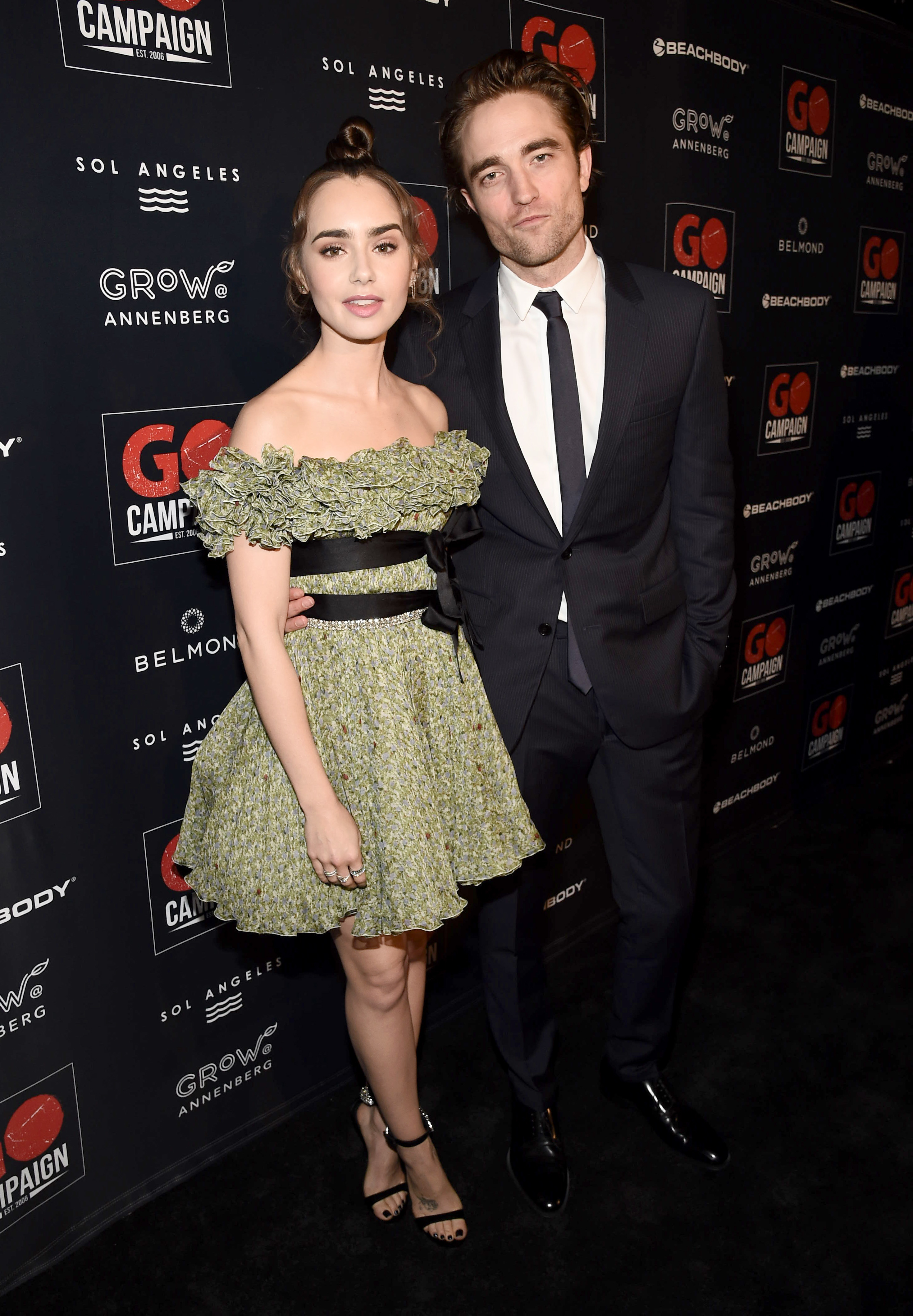 Lily Collins and Robert Pattinson attend the GO Campaign 2018 Gala in Los Angeles on Oct. 20, 2018.