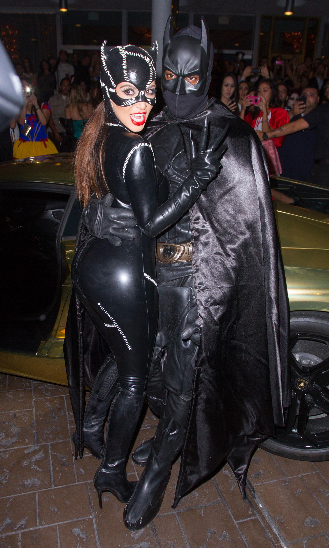 Kim Kardashian and Kanye West arrive at Kim Kardashian's Halloween party at LIV nightclub at Fontainebleau Miami in Miami Beach, Florida on Oct. 31, 2012.