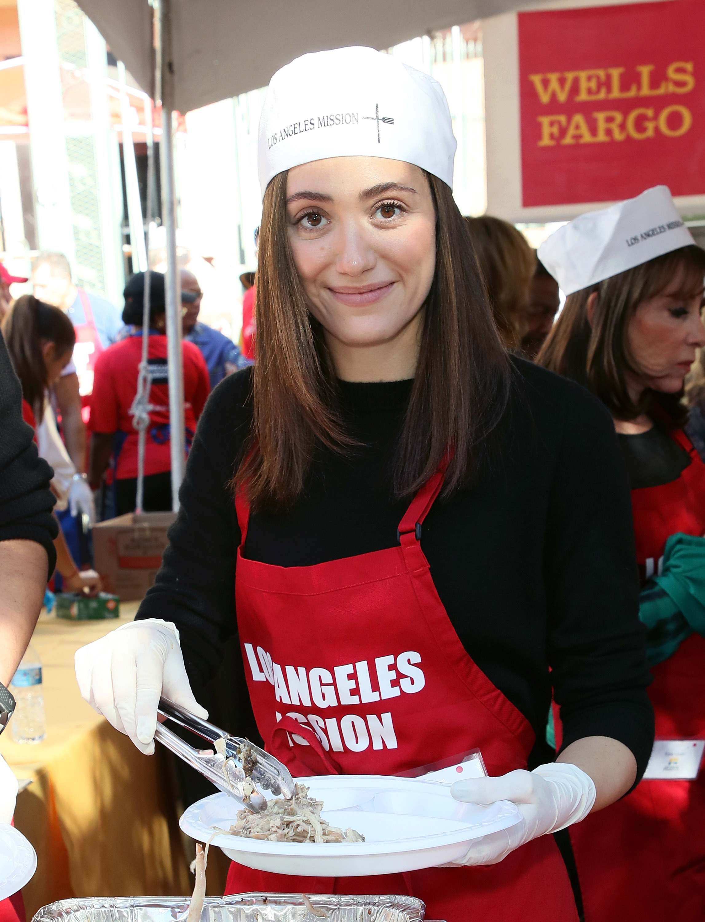 Emmy Rossum attends the Los Angeles Mission Thanksgiving Meal for the homeless at the Los Angeles Mission in Los Angeles on Nov. 22, 2017.