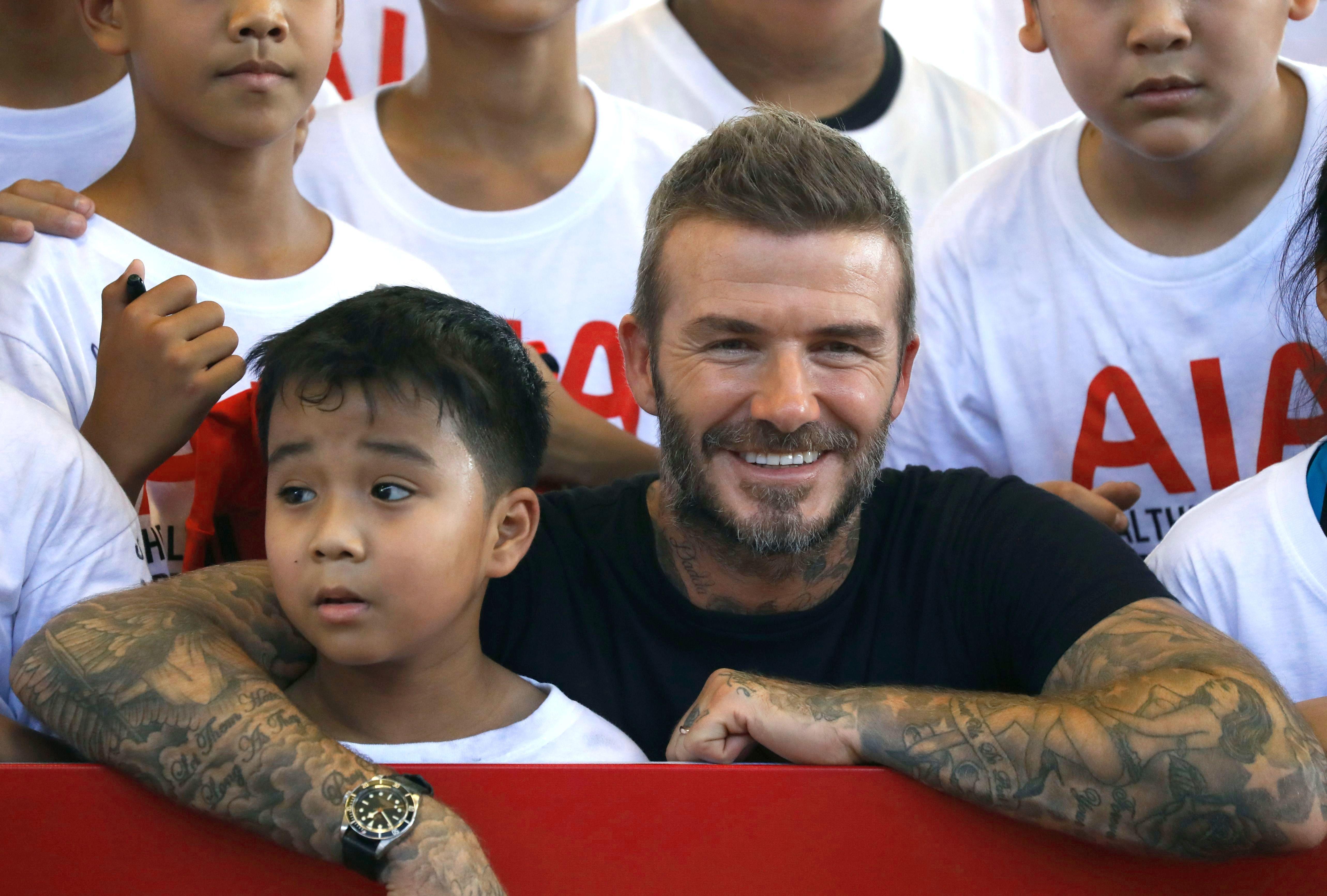 David Beckham poses for a group photo with Thai youths during AIA's Football Clinic for Youth event at SCG Muangthong United soccer club in Nonthaburi province, on the outskirts of Bangkok, Thailand, on Nov. 3, 2018.