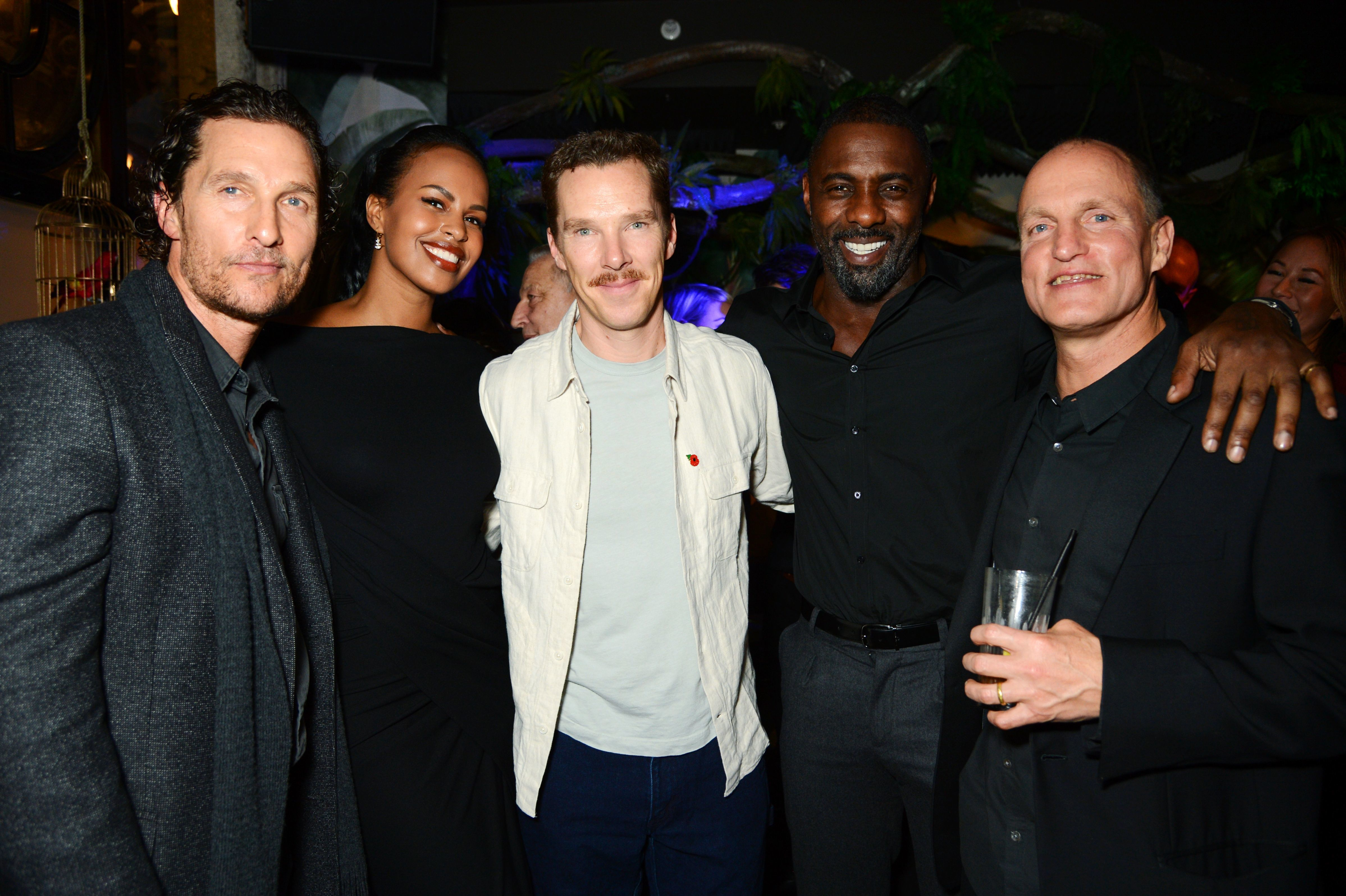 Matthew McConaughey, Sabrina Dhowre, Benedict Cumberbatch, Idris Elba and Woody Harrelson attend The Parrot opening in London on Nov. 8, 2018.