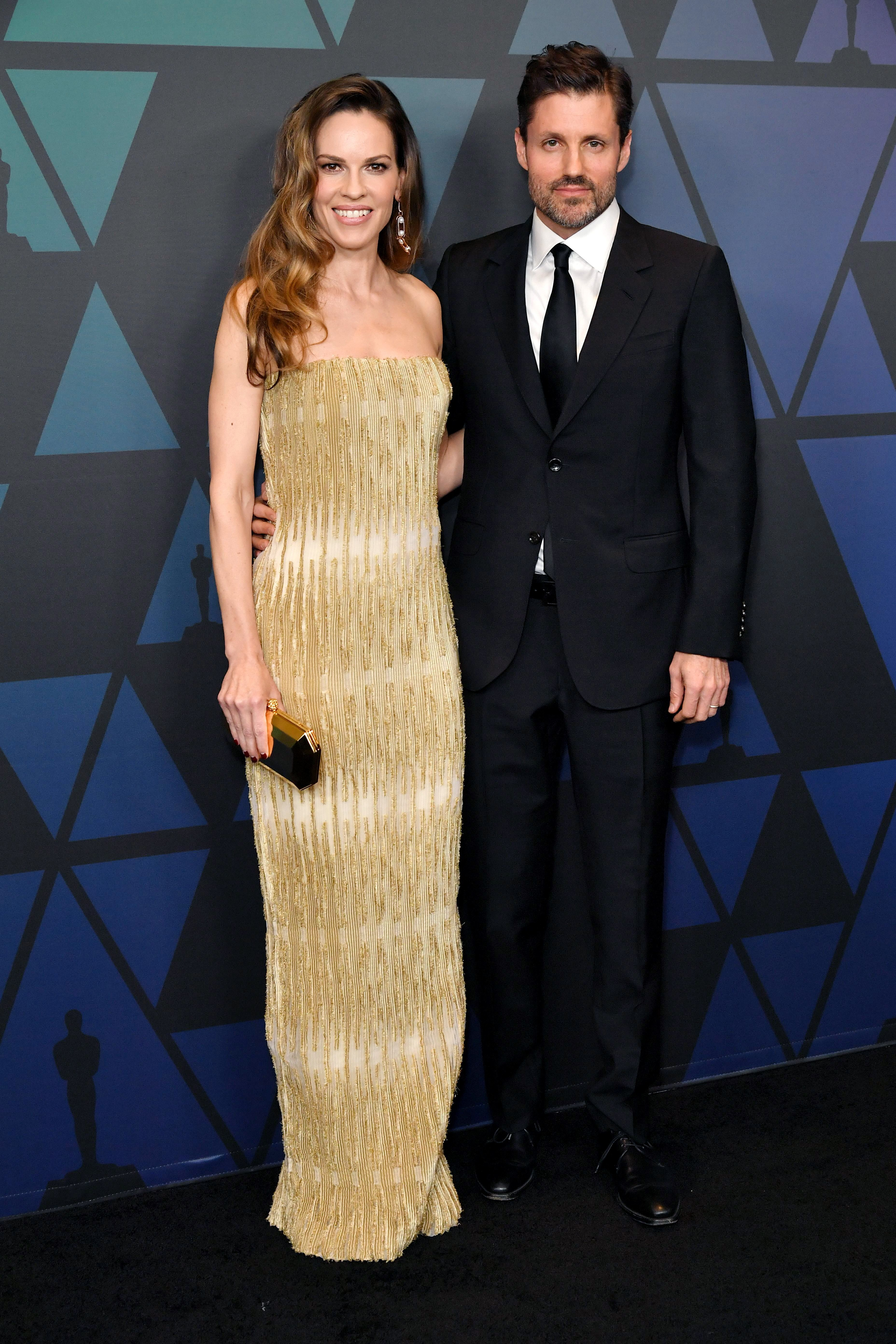 Hilary Swank and husband Philip Schneider attend the Academy of Motion Picture Arts and Sciences' Governors Awards at the Ray Dolby Ballroom at the Hollywood & Highland Center in Hollywood on Nov. 18, 2018.