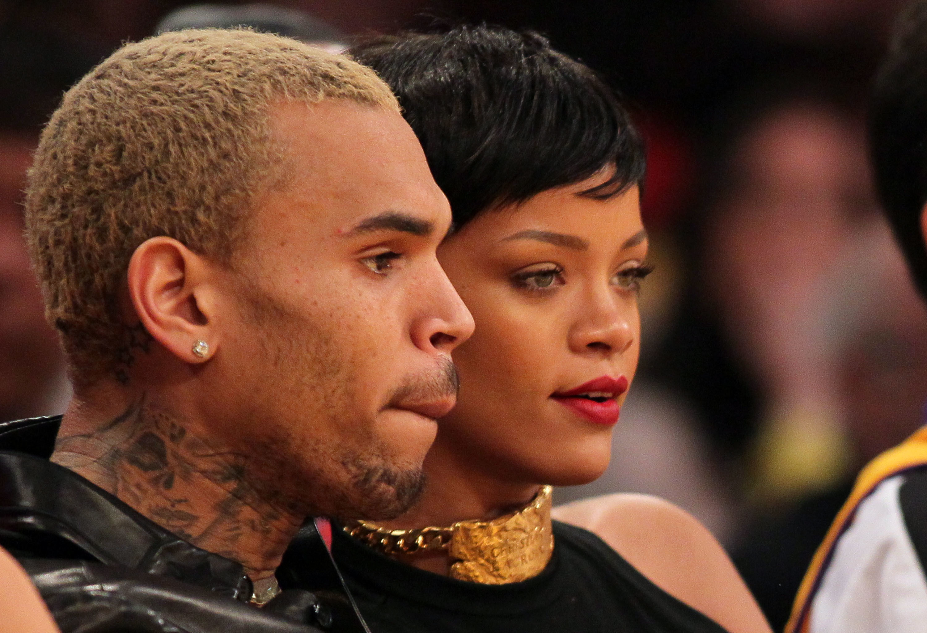 Chris Brown and Rihanna attend an NBA game between the New York Knicks and the Los Angeles Lakers at the Staples Center in Los Angeles on Dec. 25, 2012.