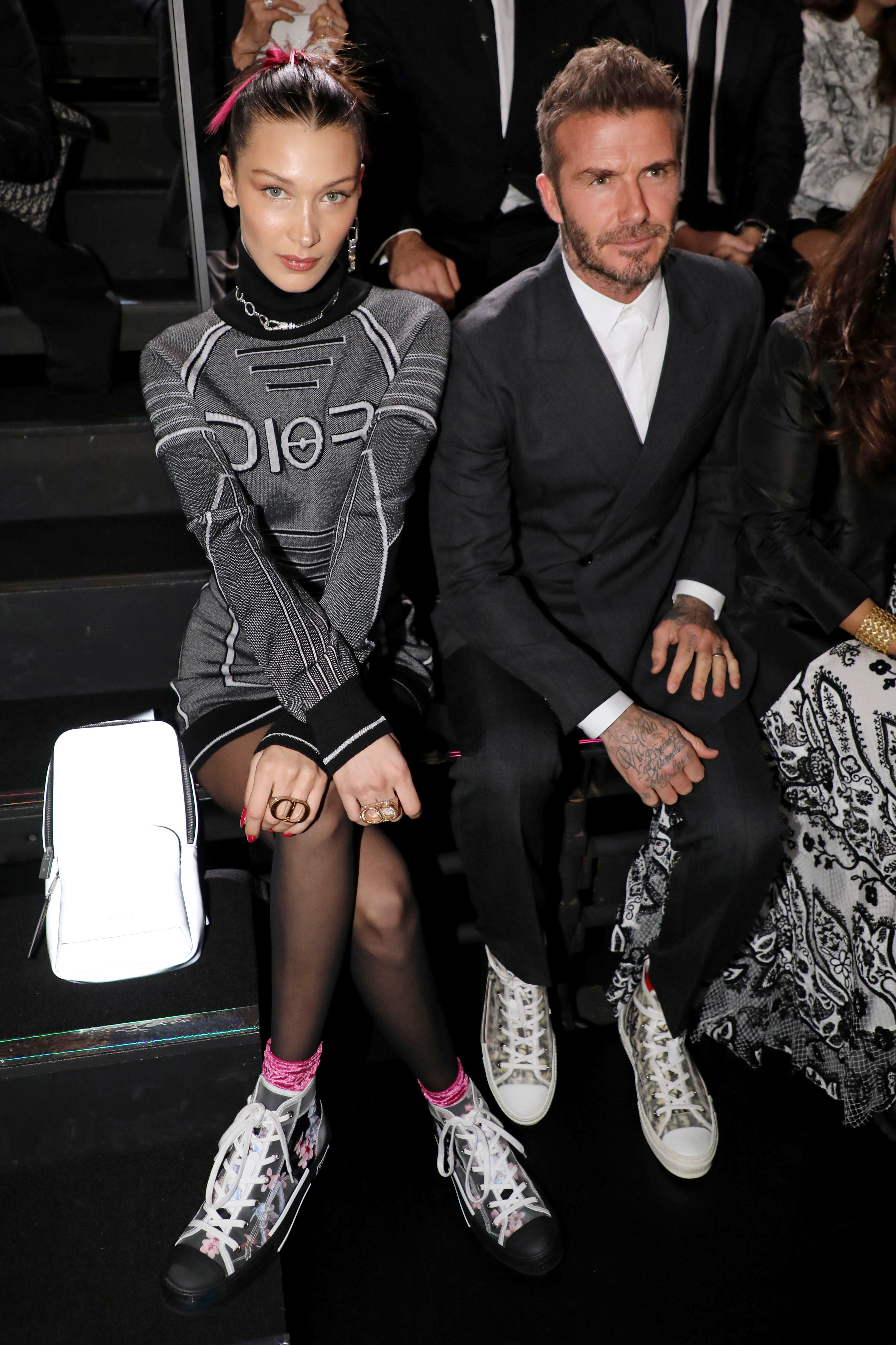 Bella Hadid and David Beckham sit in the front row for the Dior Homme show in Tokyo, Japan, on Nov. 30, 2018.