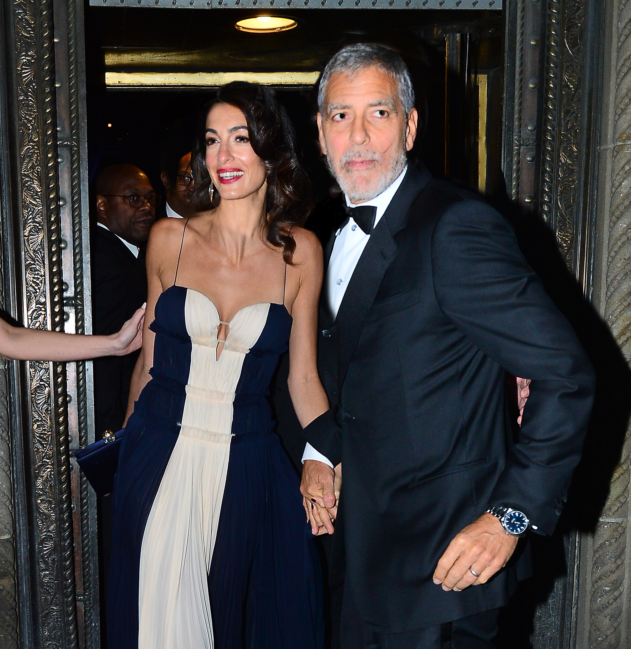 Amal Clooney and George Clooney are all smiles as they leave the United Nations Correspondence Association dinner at Cipriani 42nd in New York City on Dec. 5, 2018.