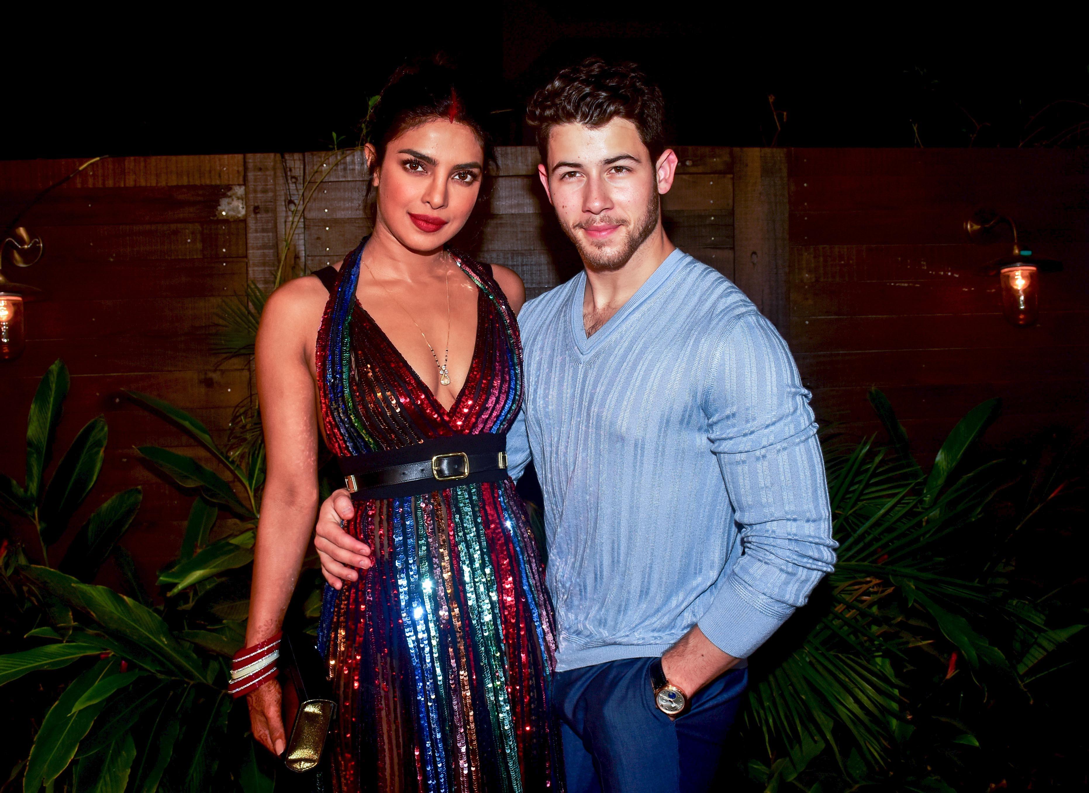 Priyanka Chopra and Nick Jonas pose at Bumble's India launch party at Soho House, Juhu in Mumbai on Dec. 7, 2018.