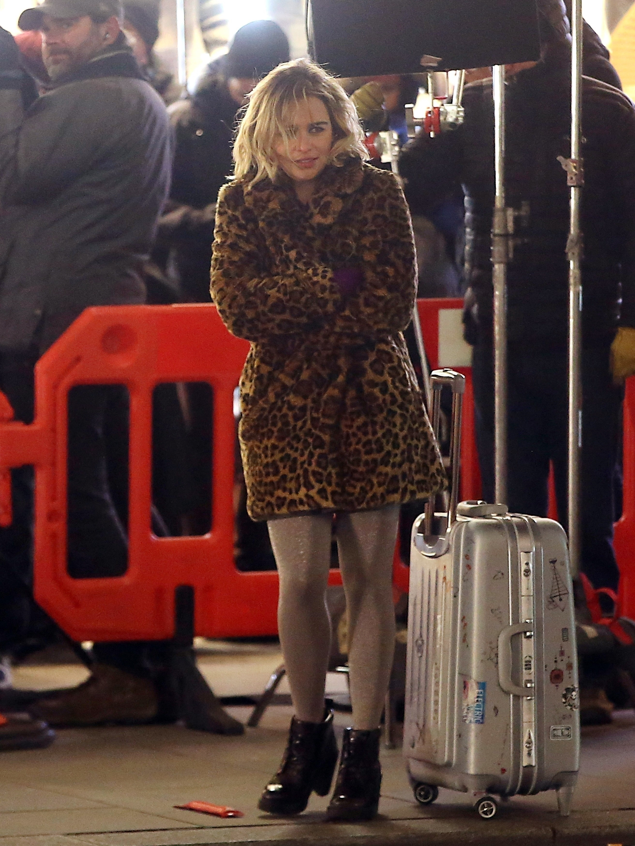 Emilia Clarke was seen trying to stay warm while filming her new movie 'Last Christmas' in London on Dec. 12, 2018.