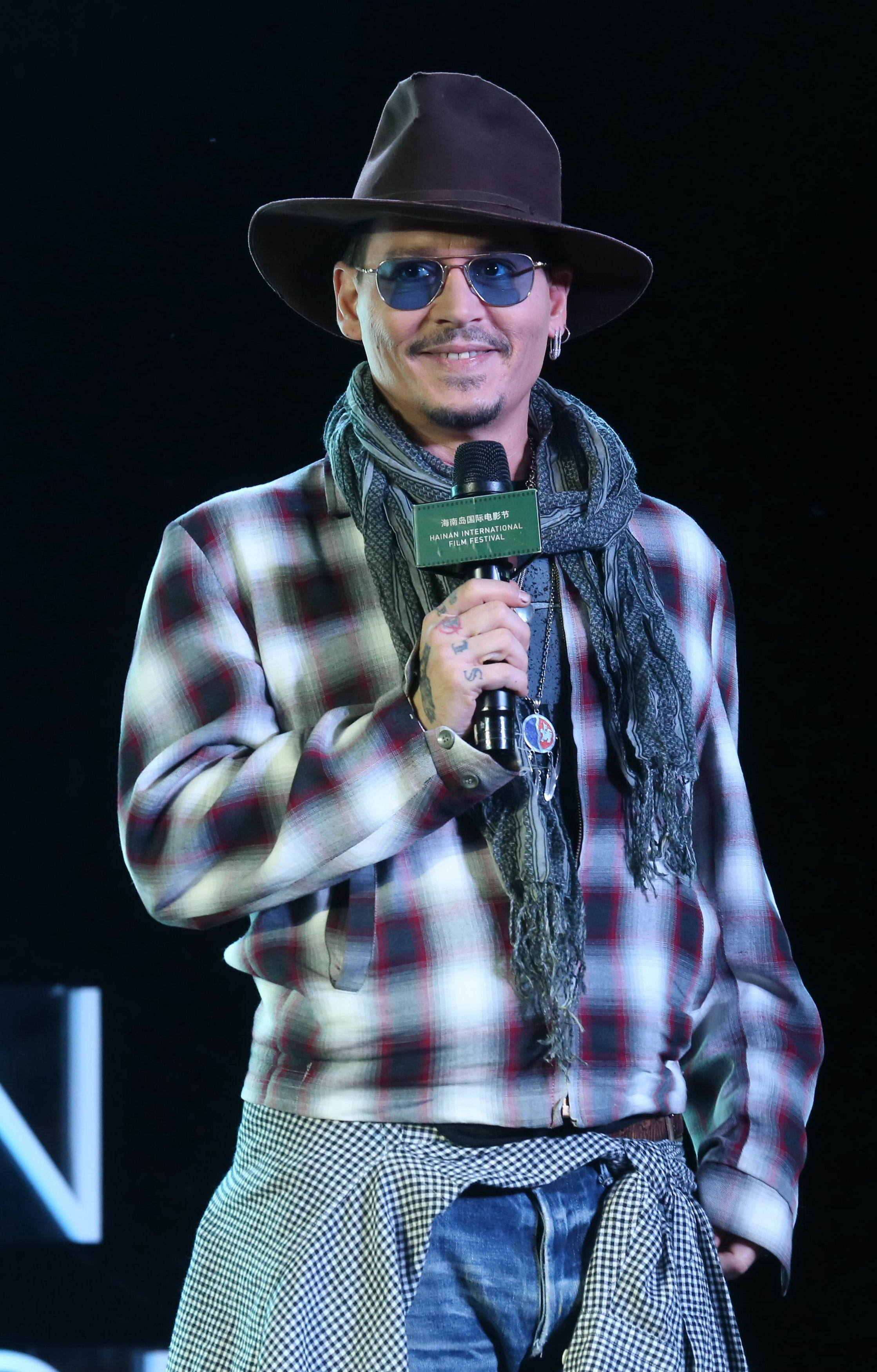 Johnny Depp spotted making out with mystery woman in Belgrade