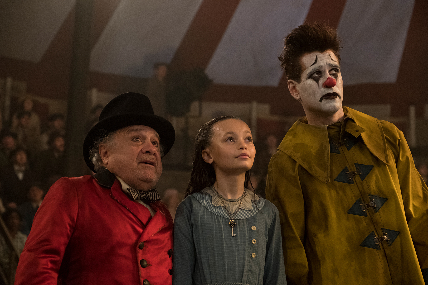 """In Tim Burton's 2019 live action reimagining of """"Dumbo,"""" circus owner Max Medici (Danny DeVito) calls on former circus star Holt Farrier (Colin Farrell) to care for a newborn elephant whose oversized ears make him a laughingstock in an already struggling circus. Holt ultimately takes his task very seriously—even donning a clown suit to help the flying elephant as he emerges as a star. Daughter Milly (Nico Parker) just might be Dumbo's biggest fan."""