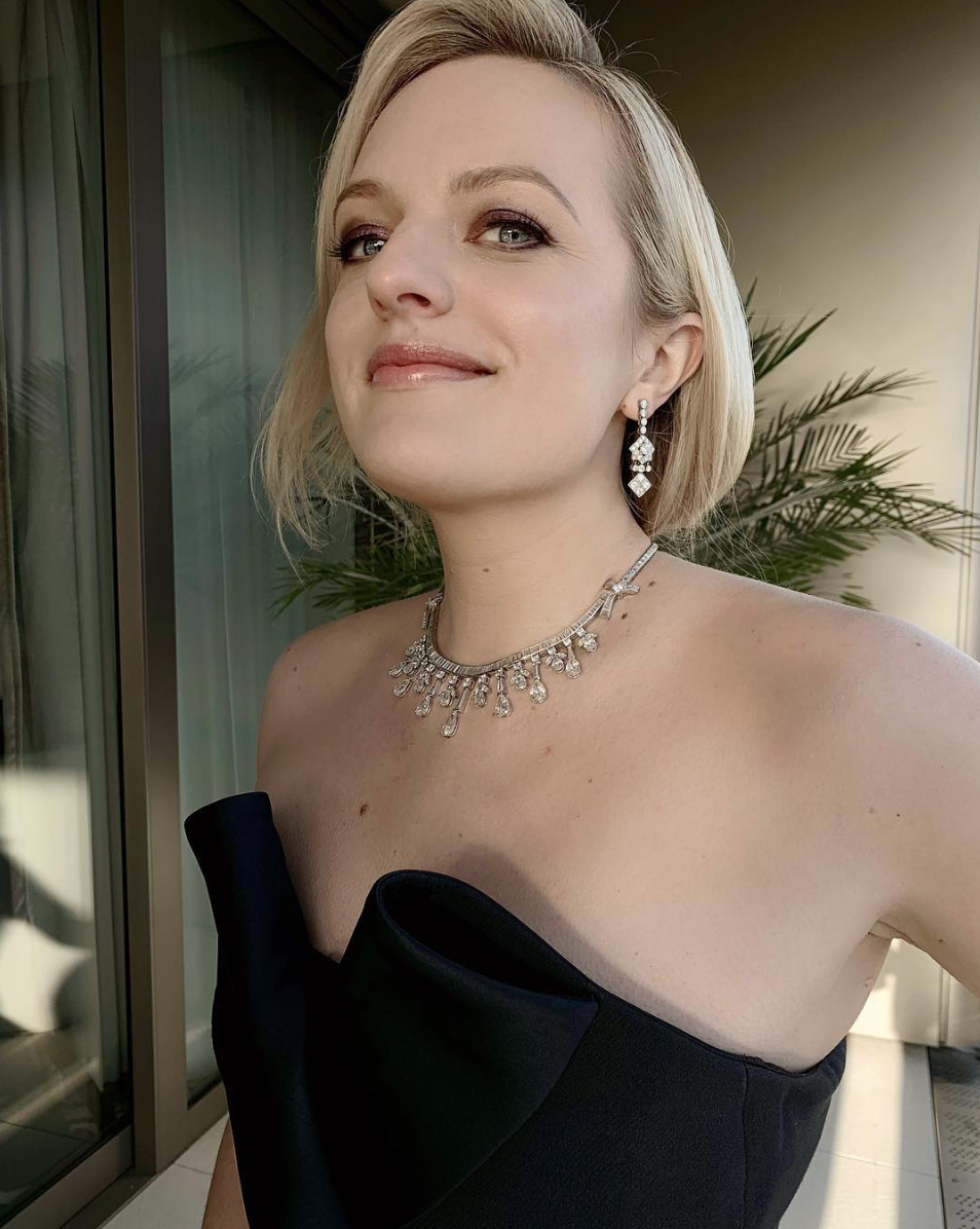 """""""""""Sparkly bruised eye"""" was my makeup inspiration for Lizzie tonight! Customized @lashify lashes and finger painted eyeshadow placement using a mix of @diormakeup @patmcgrathreal @surrattbeauty gives the intensity without looking too heavy. A mix of Navy, Lavender and Violet shades 🖤 #makeup #elisabethmoss #smokeyeye #goldenglobes""""   Daniel Martin, who posted this snap of Elisabeth Moss on Jan. 5, 2019."""
