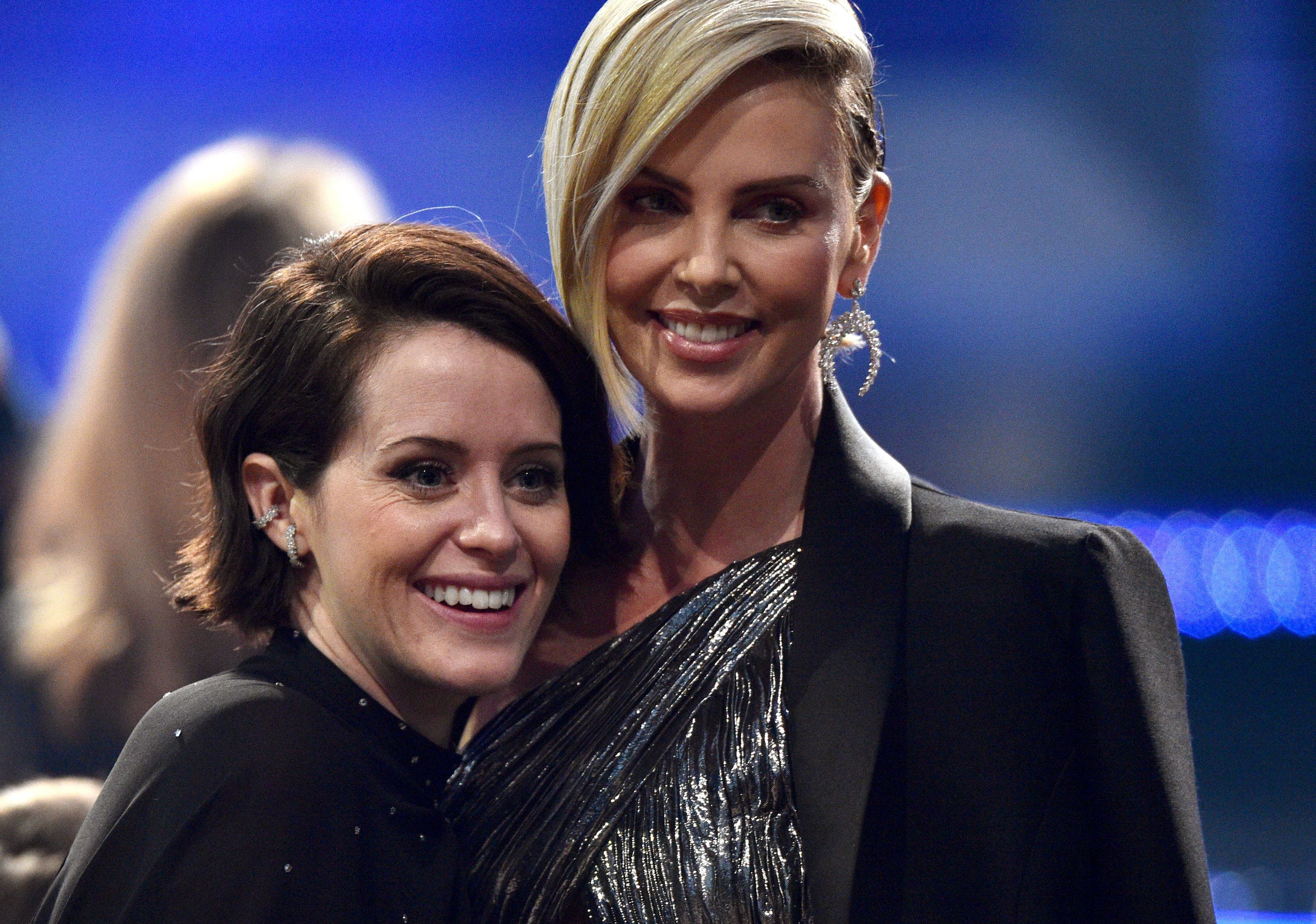 Claire Foy and Charlize Theron attend the 24th Annual Critics' Choice Awards at Barker Hangar in Santa Monica, California, on Jan. 13, 2019.