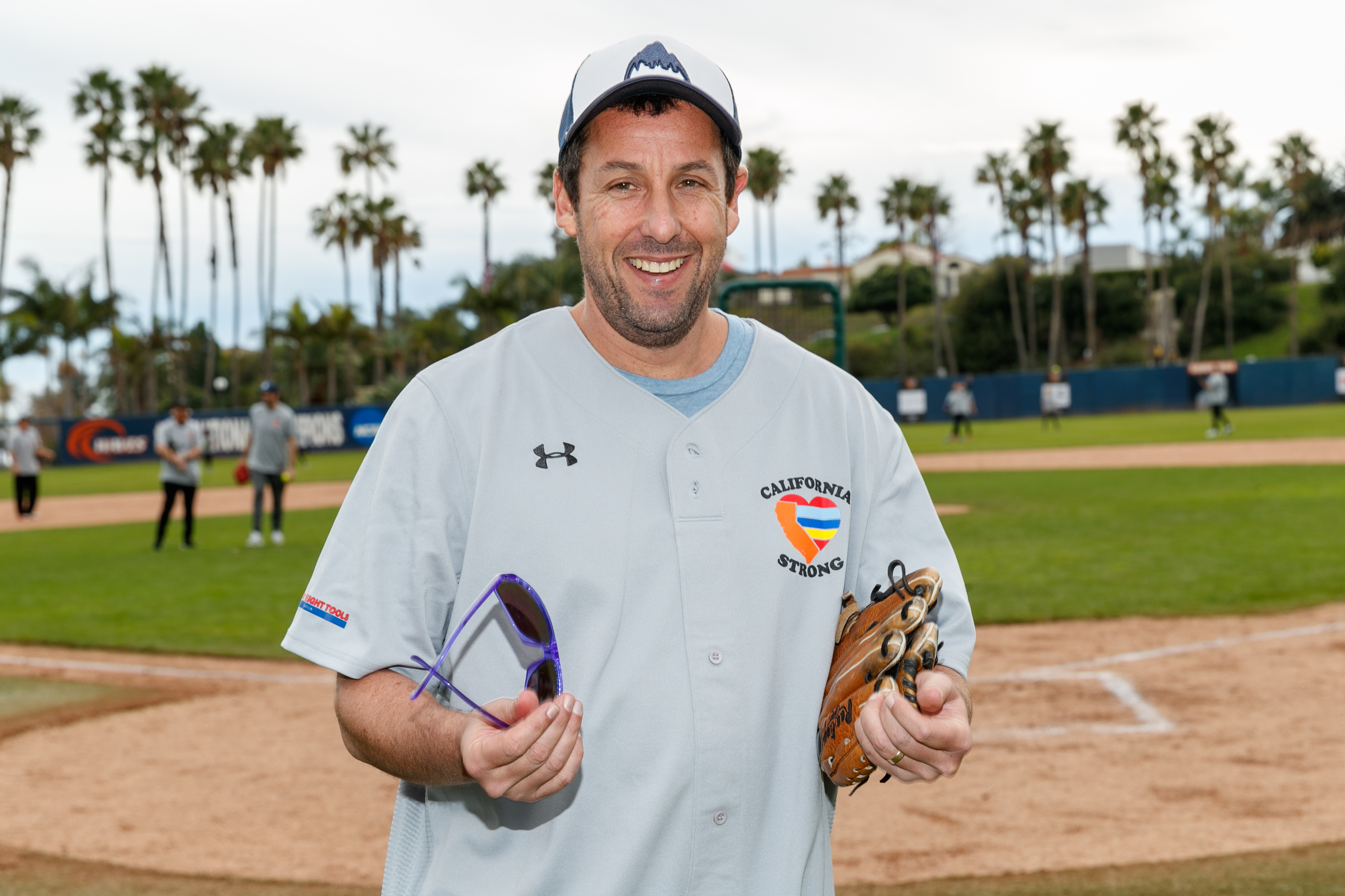 """Adam Sandler plays in a charity softball game to benefit """"California Strong"""" at Pepperdine University in Malibu, California, on Jan,13, 2019."""