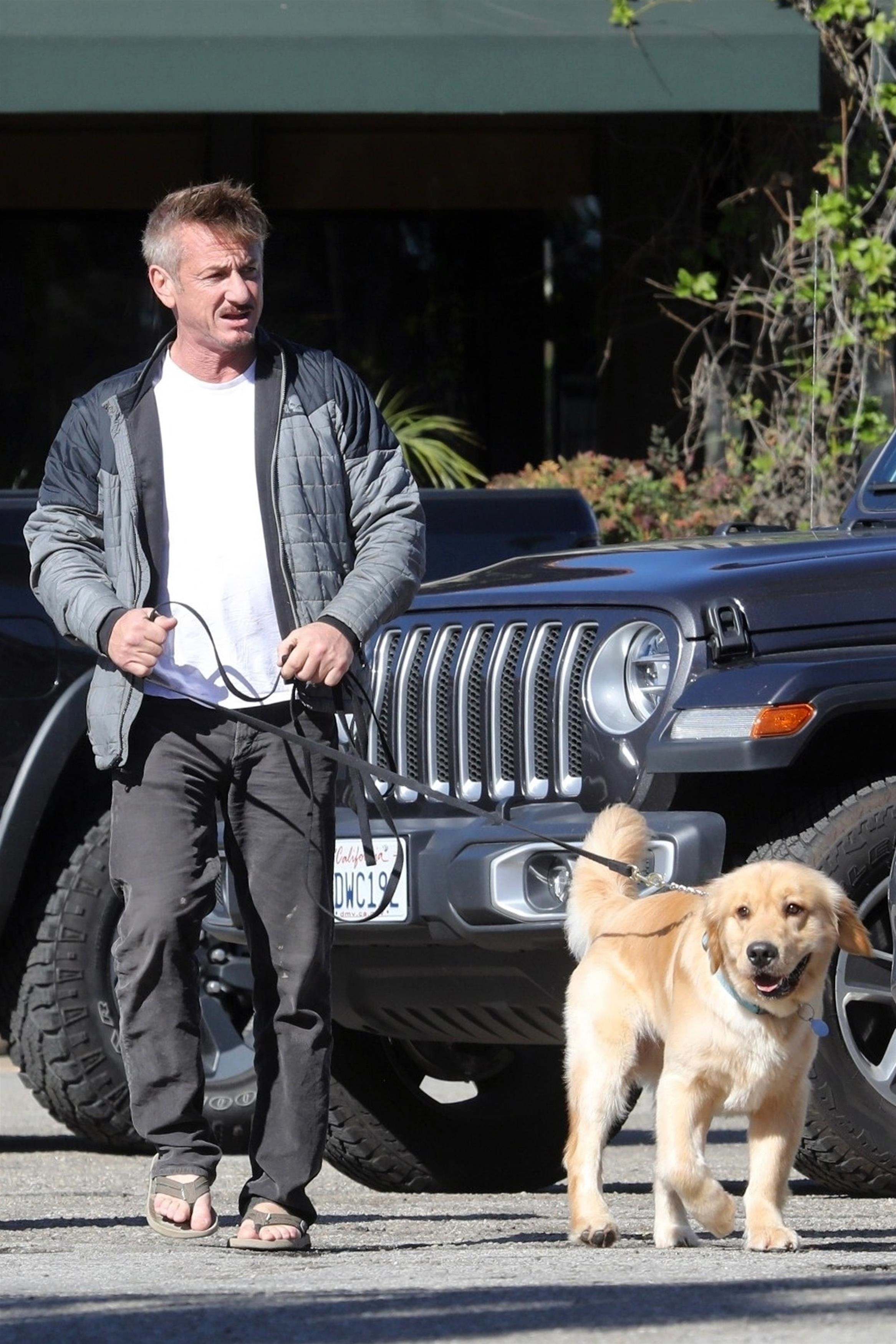 Sean Penn left brunch in Malibu's Point Dume area with his Golden Retriever on Jan. 19, 2019.