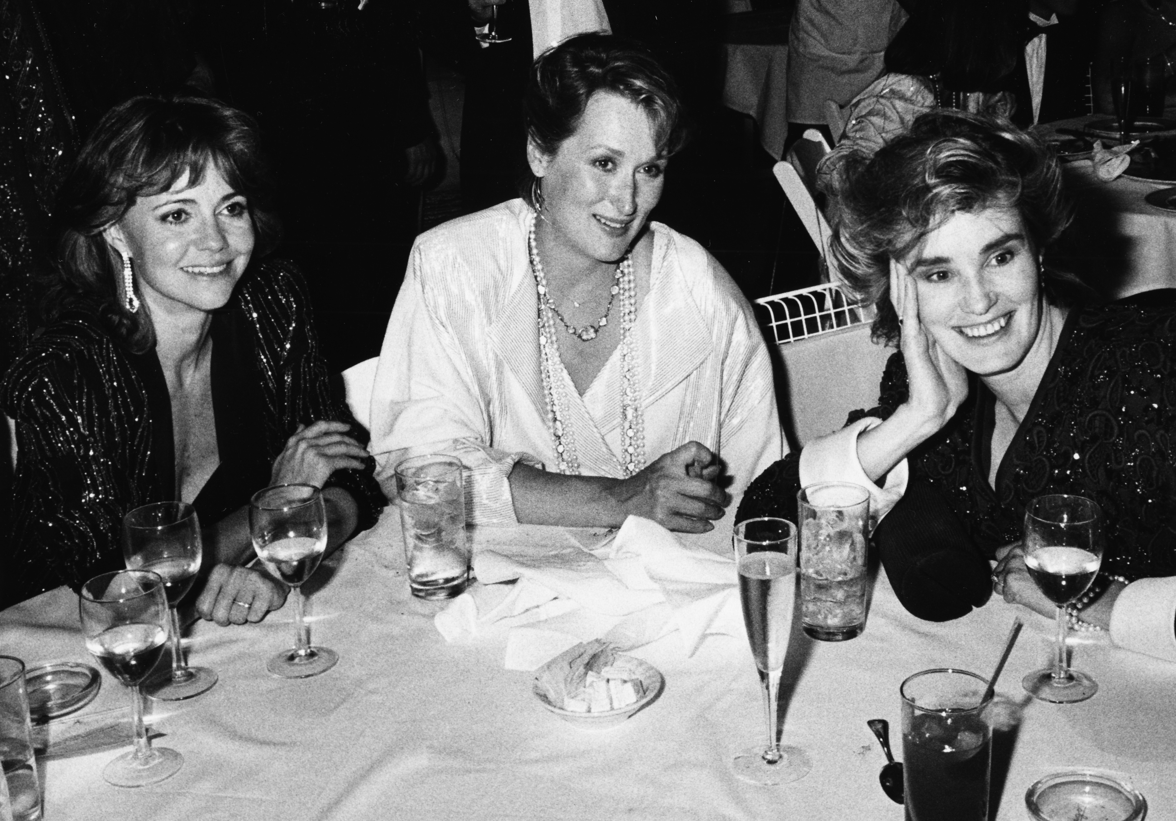 Sally Field, Meryl Streep and Jessica Lange sitting around a table together at a post Academy Awards party at Spago's in Los Angeles on March 24th 1986.
