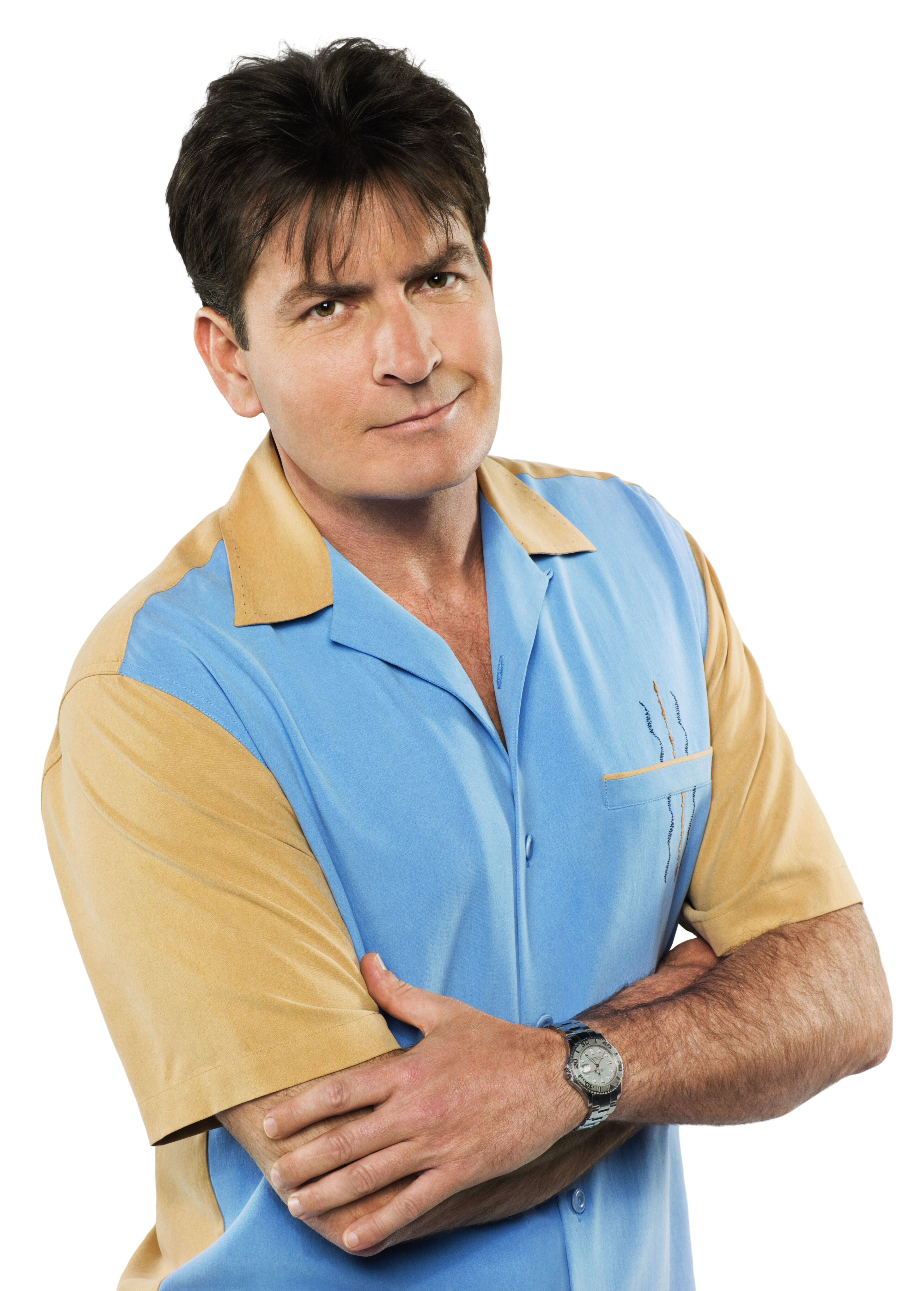 """Charlie Sheen as Charlie Harper in a promotional photo for CBS's """"Two and A Half Men"""" in 2003."""