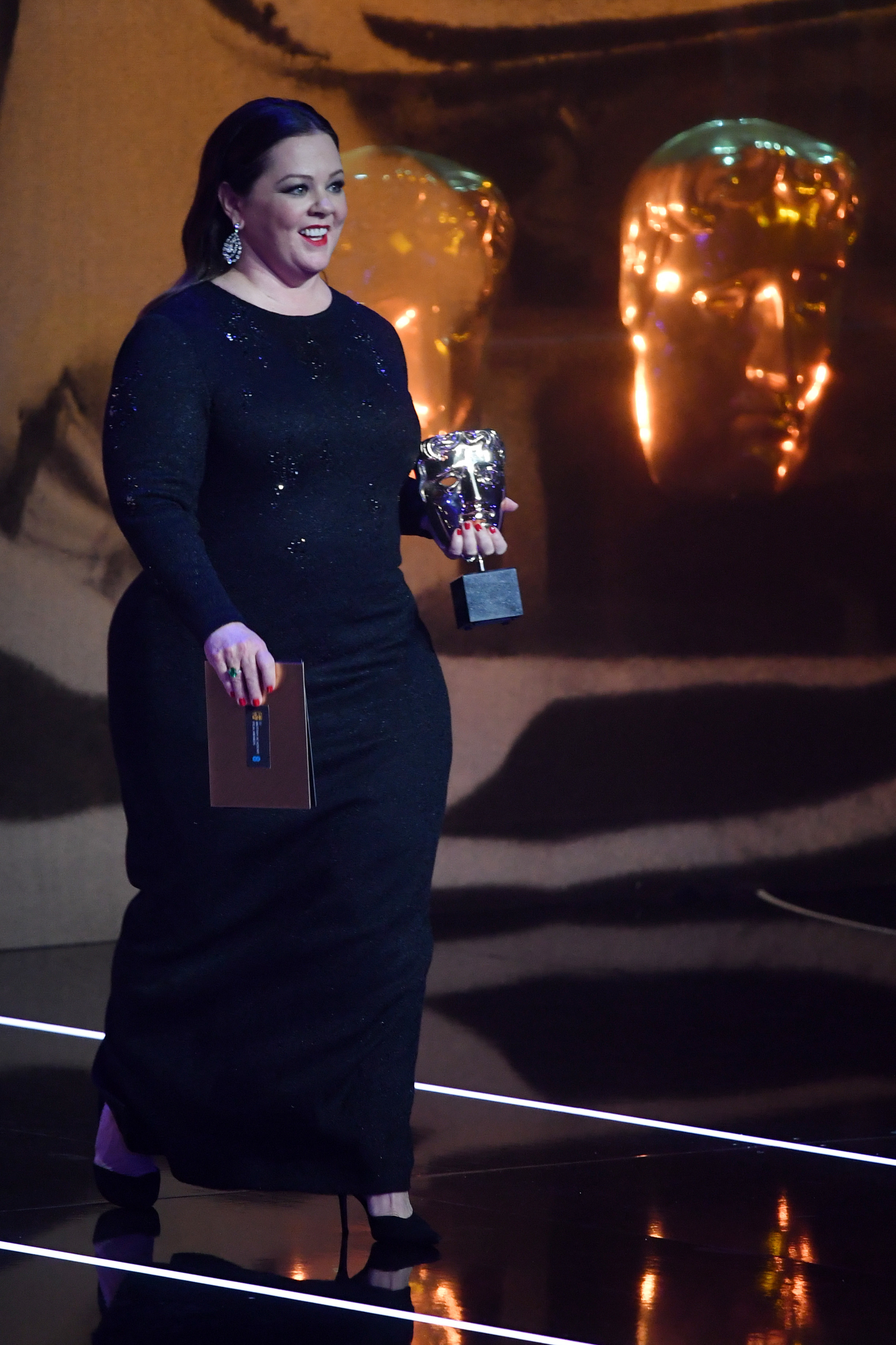 Melissa McCarthy appears onstage at the 72nd British Academy Film Awards in London on Feb. 10, 2019.