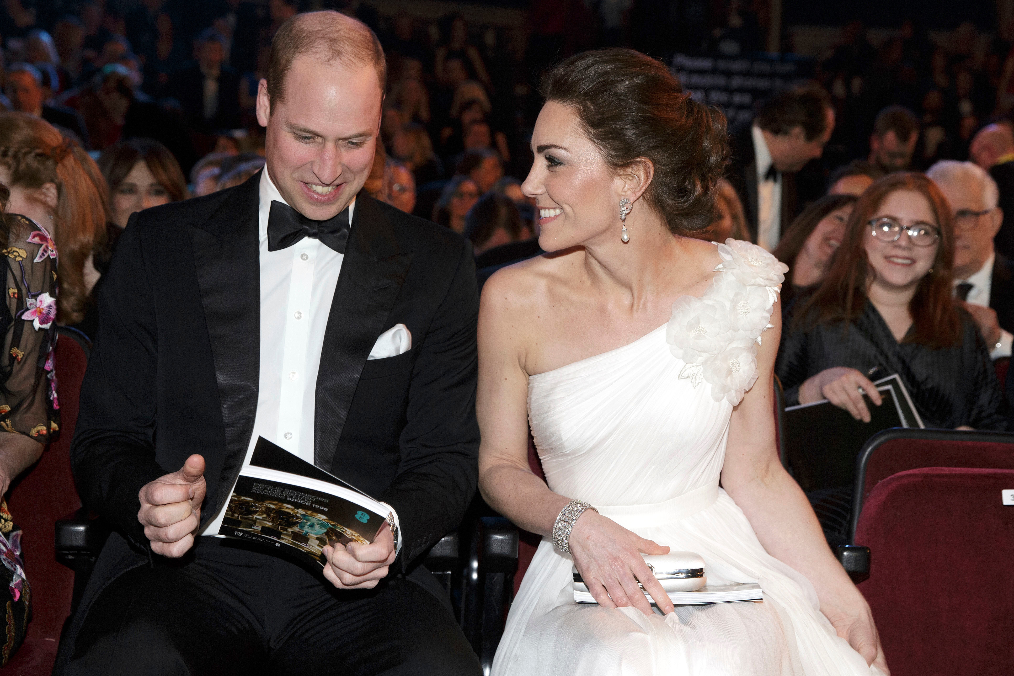 Prince William and Duchess Kate sit next to each other at the 72nd British Academy Film Awards in London on Feb. 10, 2019.