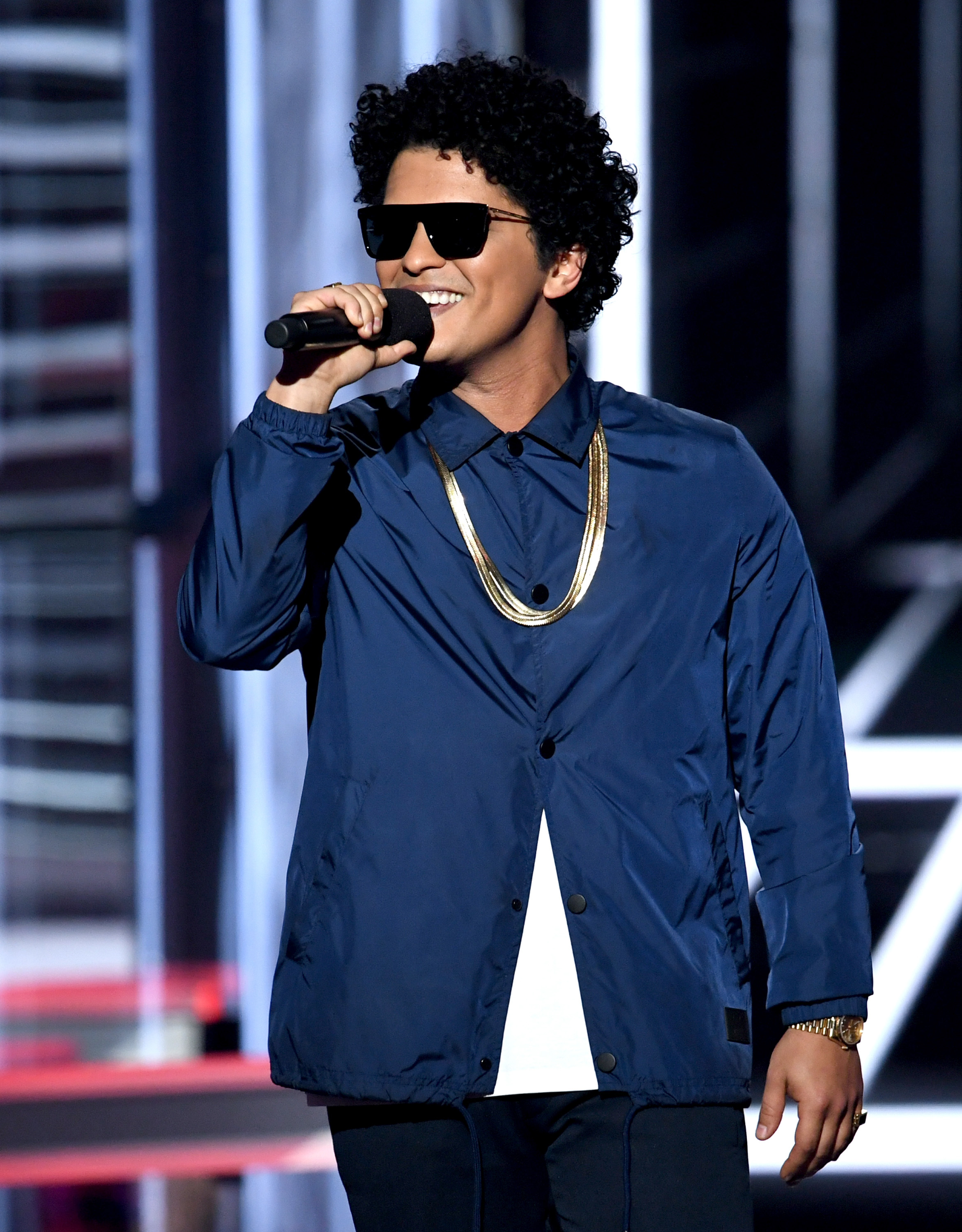 Bruno Mars speaks onstage  at the 2018 Billboard Music Awards at the MGM Grand Garden Arena on May 20, 2018 in Las Vegas, Nevada.