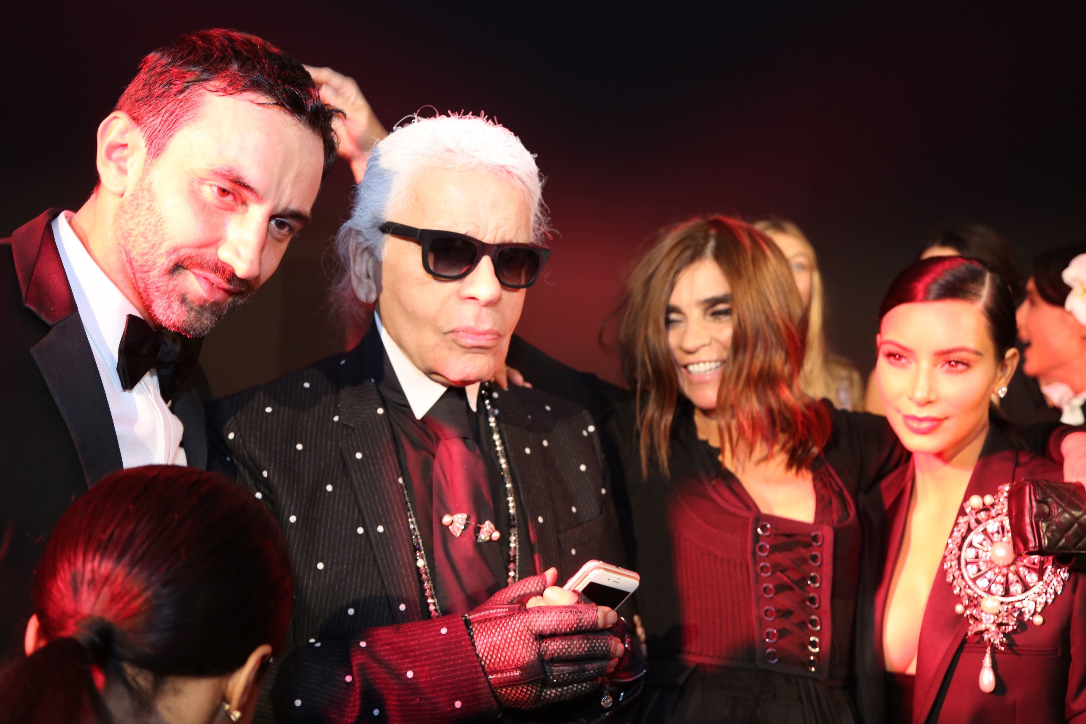 Riccardo Tisci, Karl Lagerfeld, Carine Roitfeld and Kim Kardashian West attend the CR Fashion Book Issue No.5 Launch Party hosted by Carine Roitfeld and Stephen Gan at The Peninsula Paris on Sept. 30, 2014.