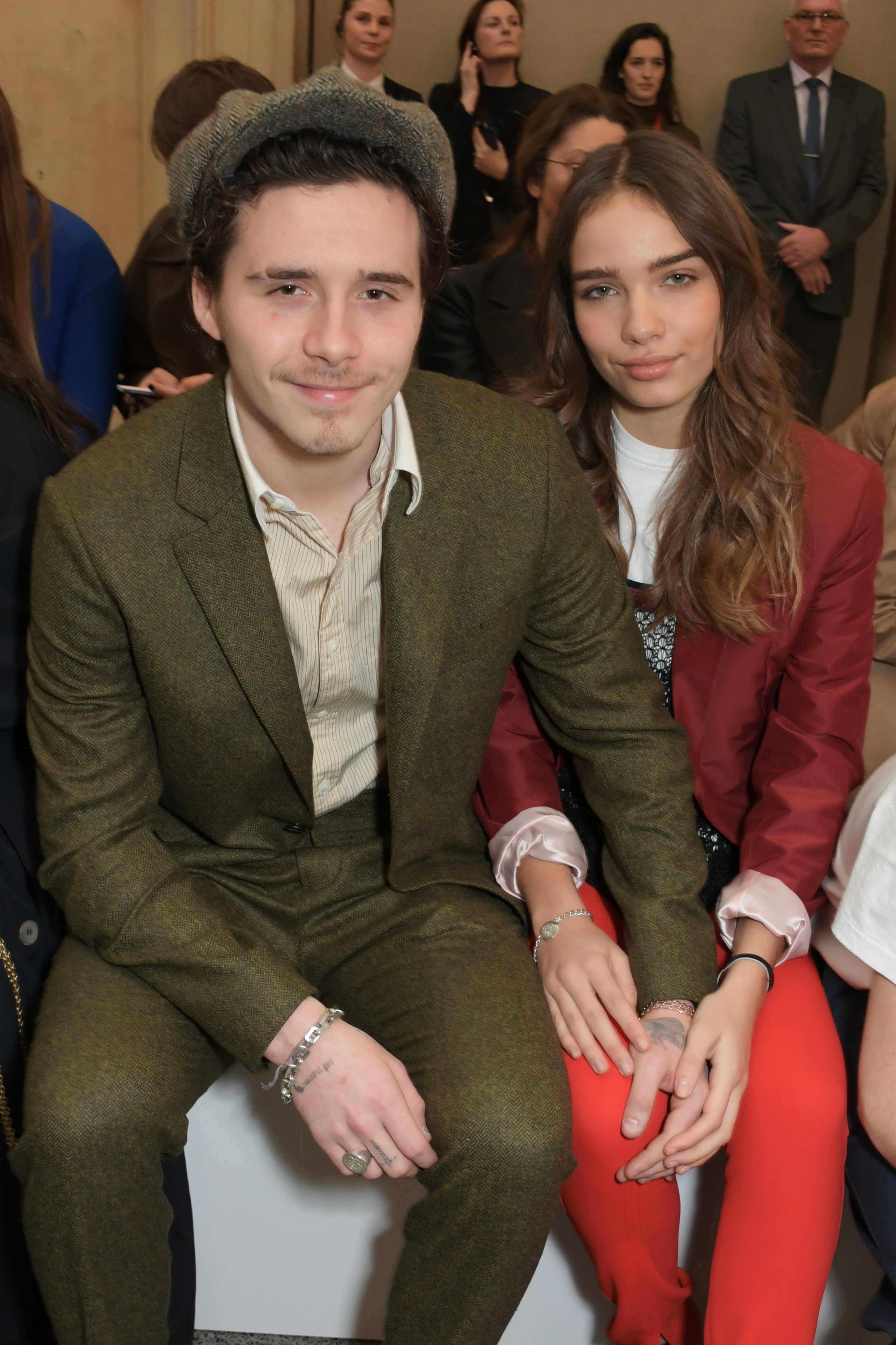 Brooklyn Beckham and Hana Cross attended the Victoria Beckham show during London Fashion Week  at the Tate in London on Feb. 17, 2019.