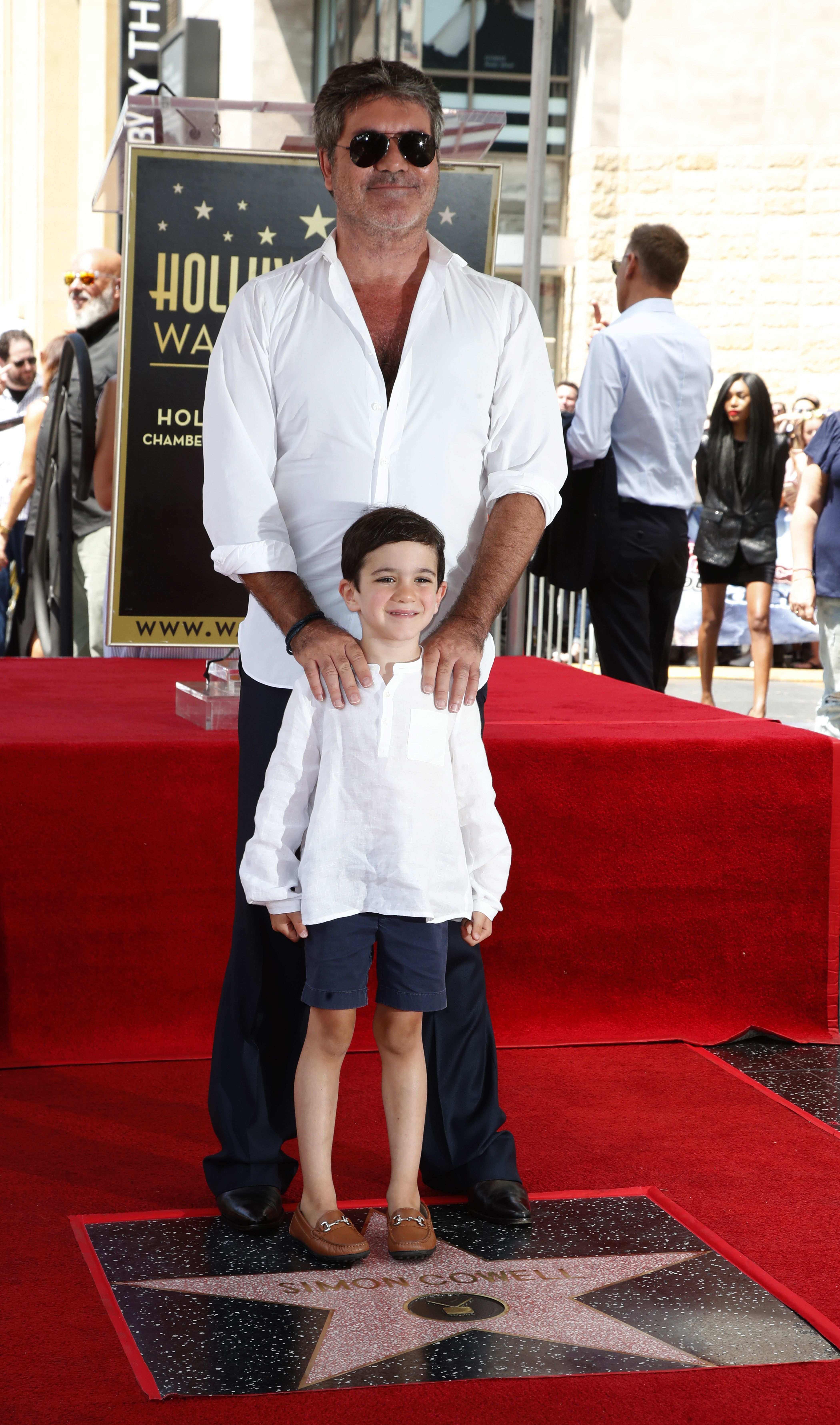 Simon Cowell and his son, Eric, attend his Hollywood Walk of Fame star ceremony on Aug. 22, 2018.