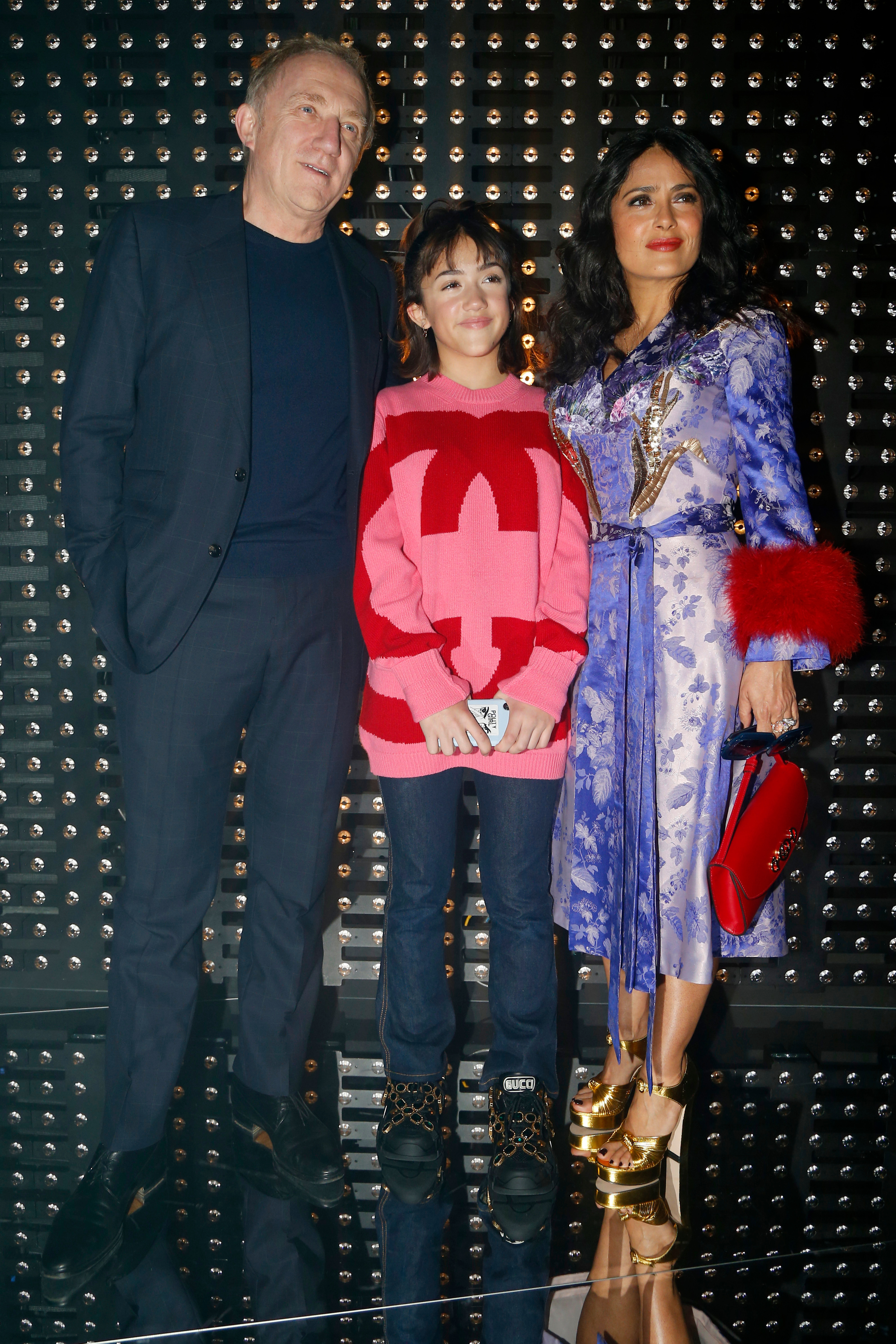Francois Henri Pinault, Valentina Paloma Pinault and Salma Hayek appear in the front row of the Gucci show for Fall/Winter 2019 at Milan Fashion Week on Feb. 20, 2019.