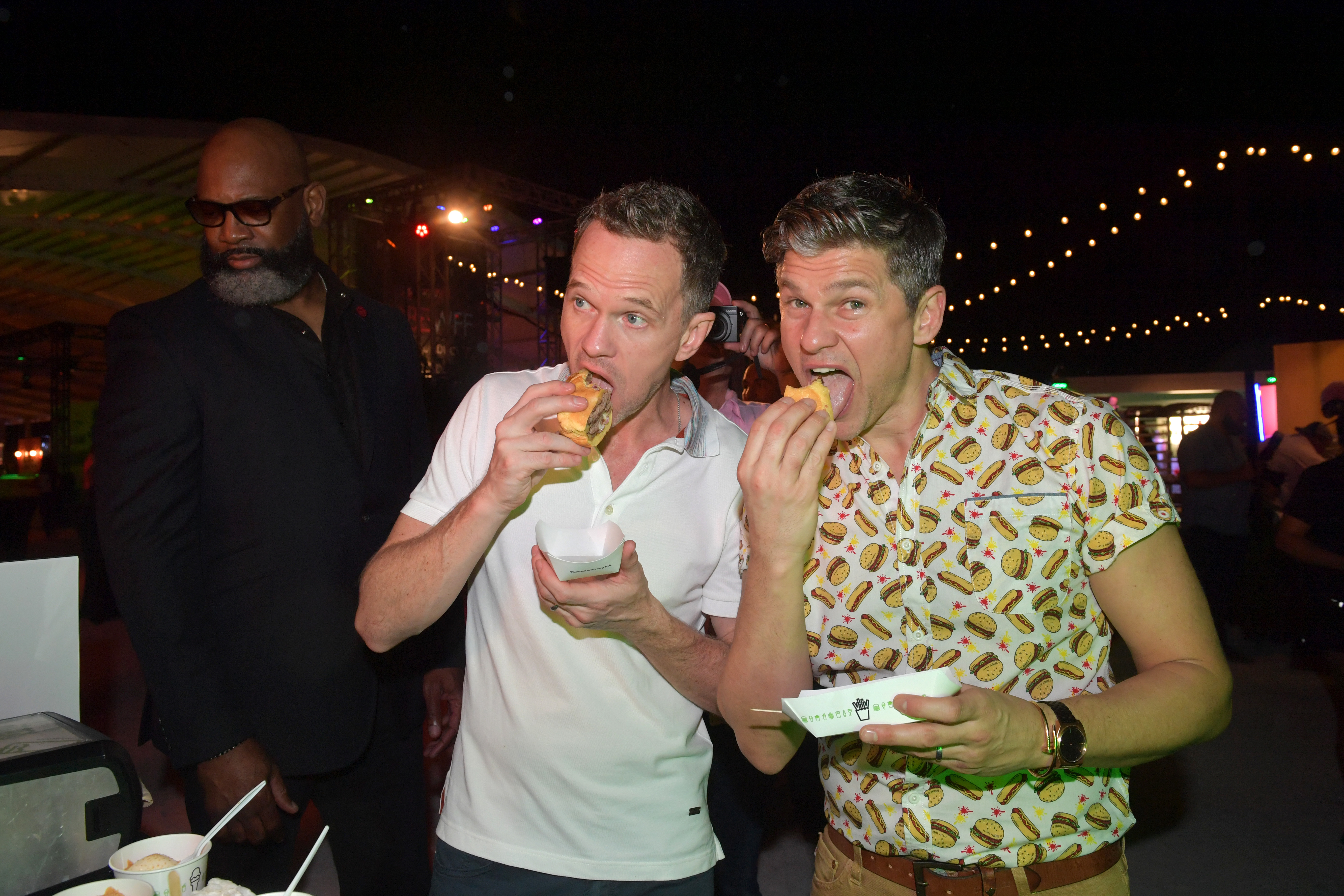Neil Patrick Harris and David Burtka attend the South Beach Wine and Food Festival in Miami on Feb. 22, 2019.