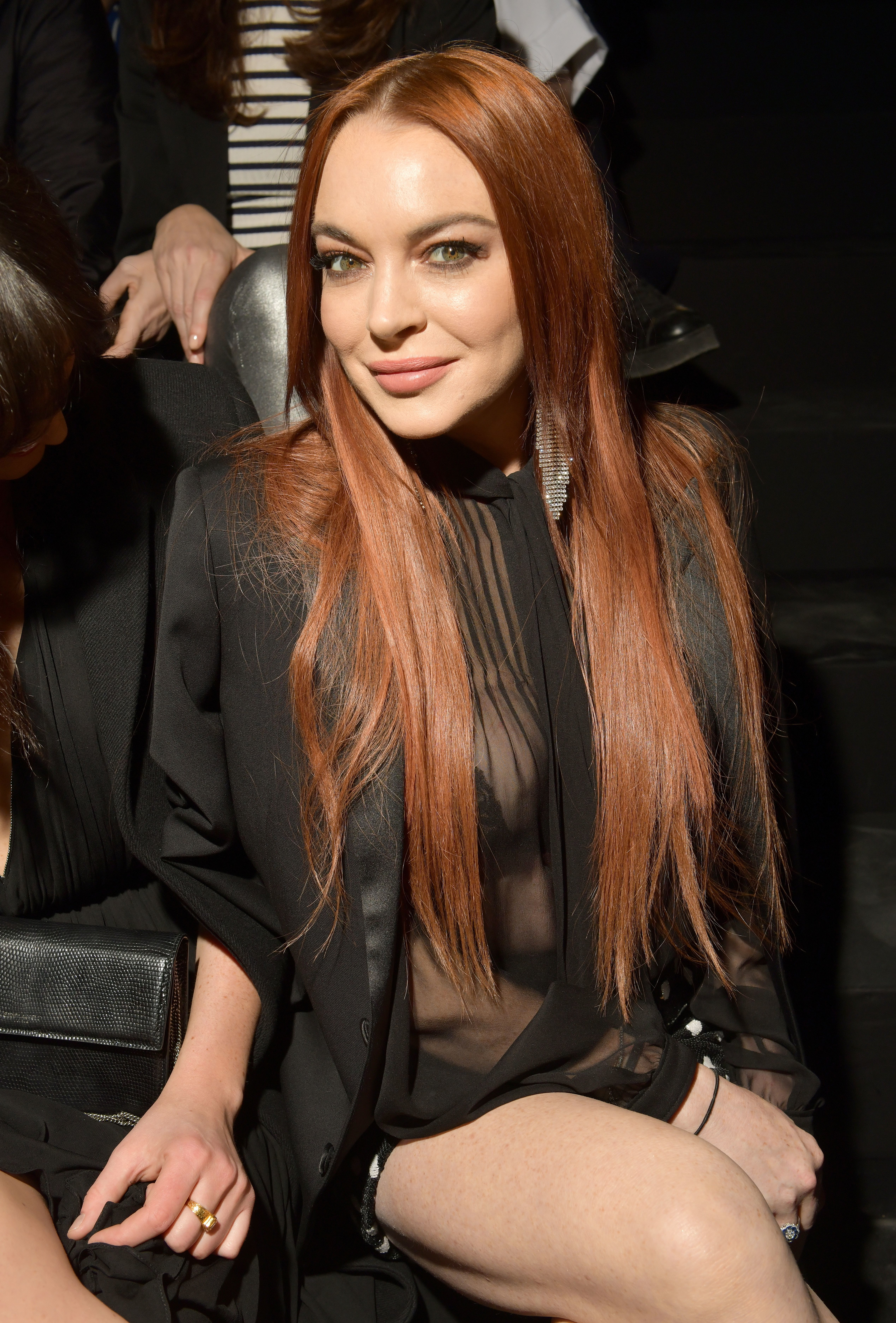 Lindsay Lohan appears in the front row of the Saint Laurent show for Fall/Winter 2019 at Paris Fashion Week on Feb. 26, 2019.